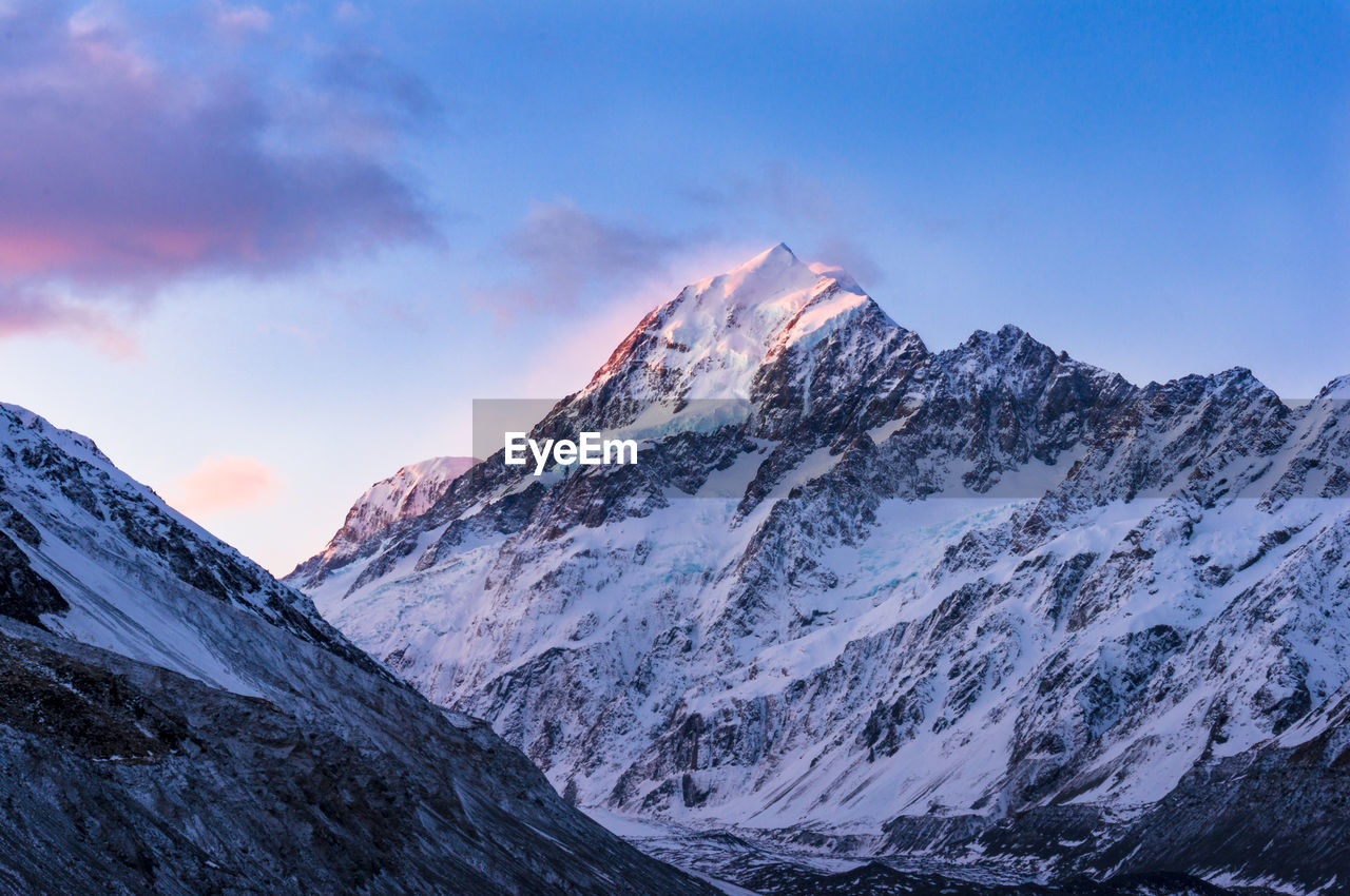 mountain, cold temperature, beauty in nature, snow, winter, sky, scenics - nature, tranquil scene, mountain range, snowcapped mountain, cloud - sky, tranquility, environment, nature, landscape, non-urban scene, no people, idyllic, rock, mountain peak, outdoors, formation