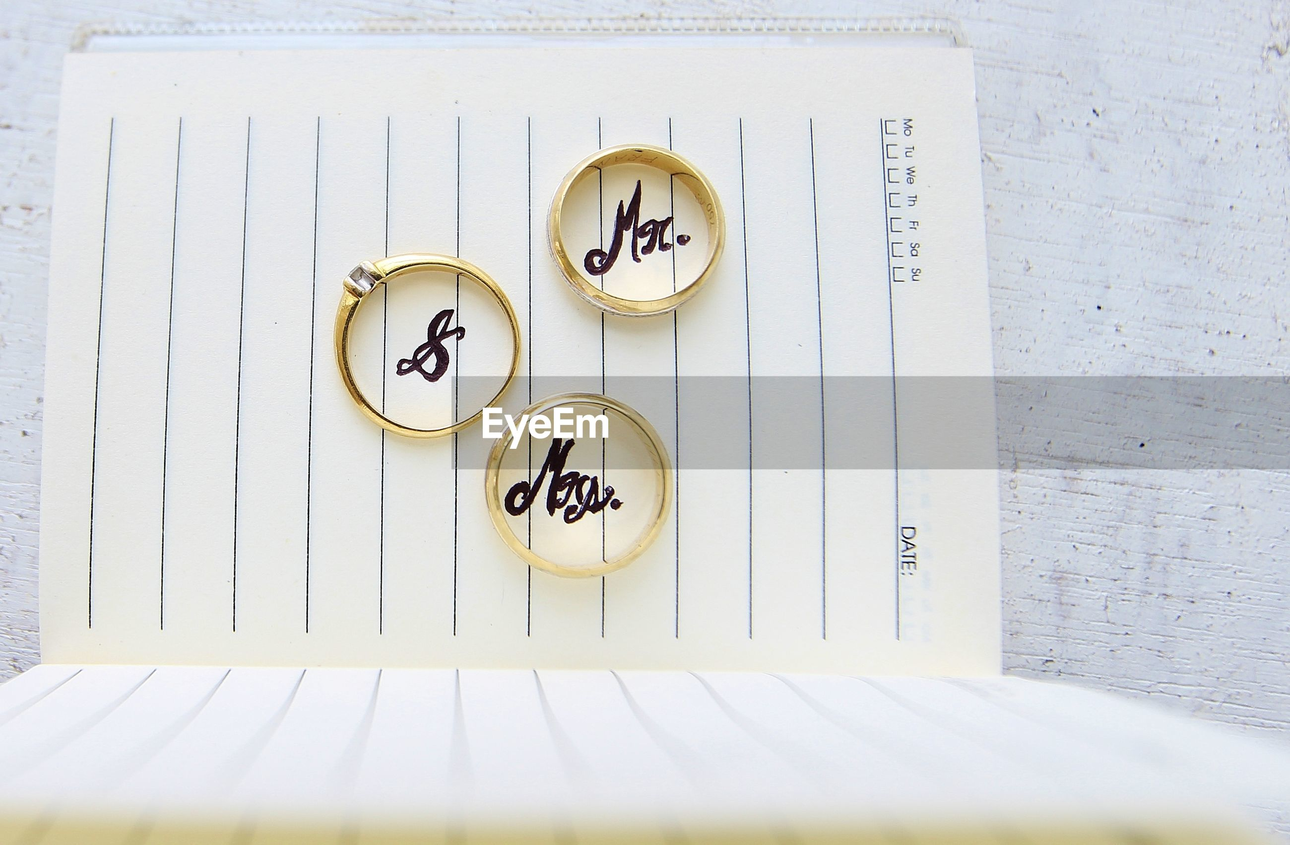 High angle view of rings with text on diary