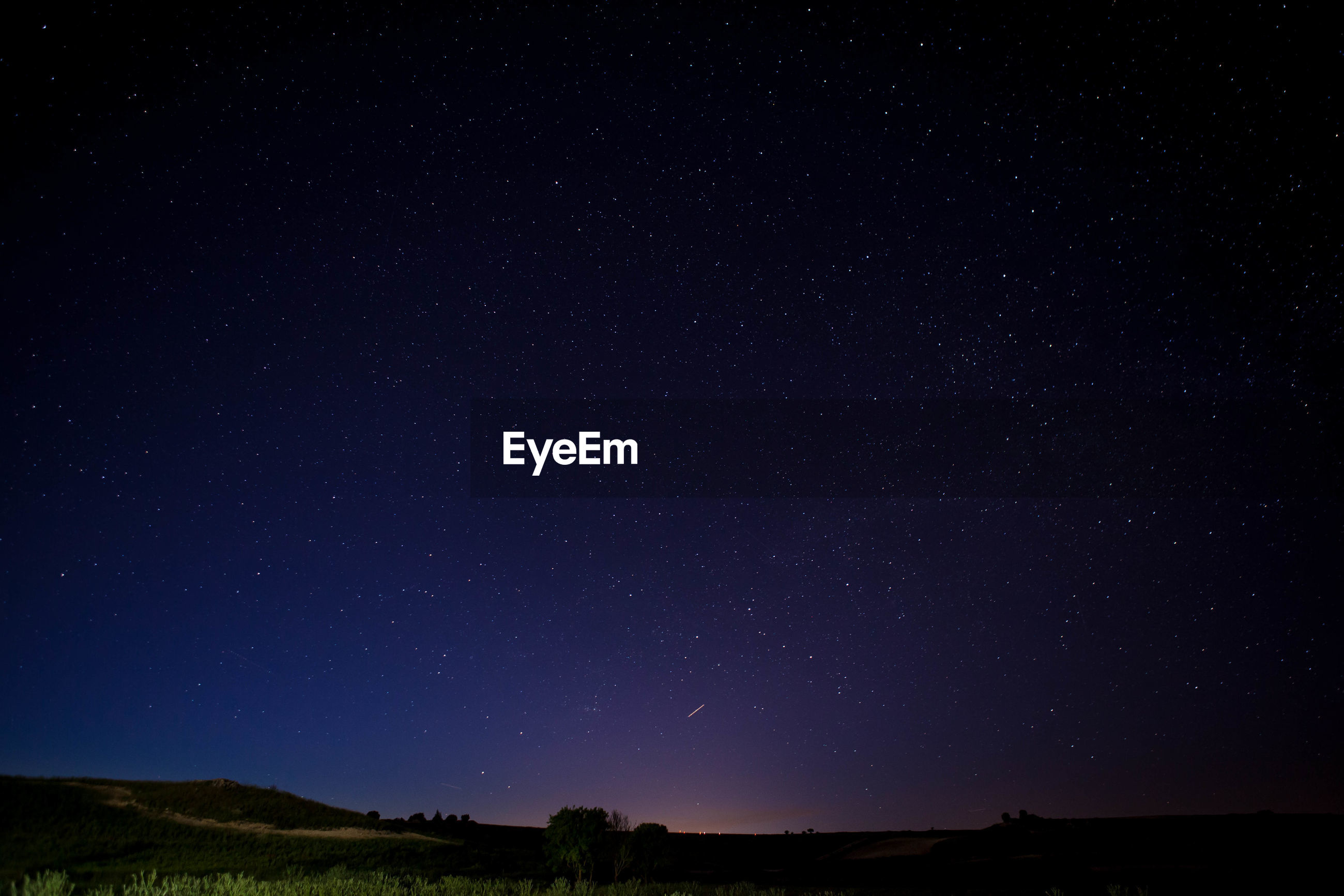 LOW ANGLE VIEW OF STAR FIELD AGAINST SKY