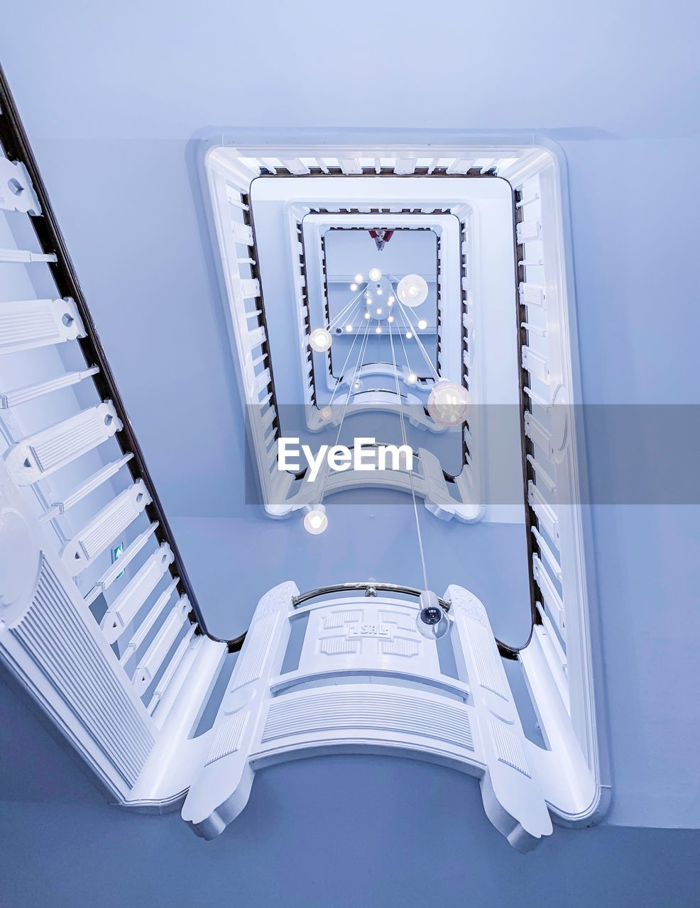 no people, architecture, indoors, building, blue, day, built structure, steps and staircases, staircase, white color, railing, design, close-up, technology, pattern, metal, high angle view, direction, directly below