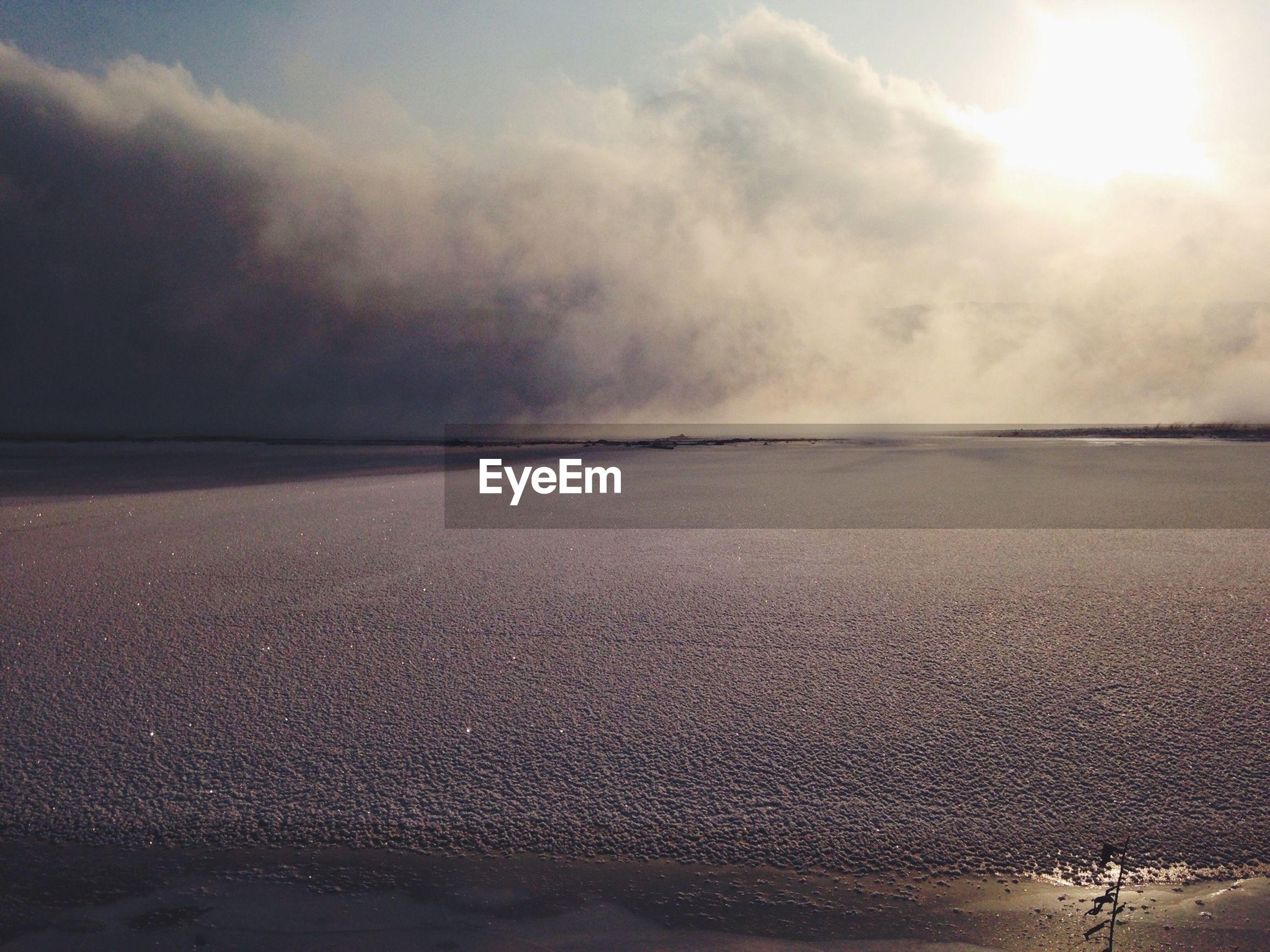 sea, beach, sky, water, scenics, cloud - sky, tranquil scene, horizon over water, beauty in nature, tranquility, sand, shore, nature, cloudy, sunbeam, sunlight, sun, idyllic, wave, cloud