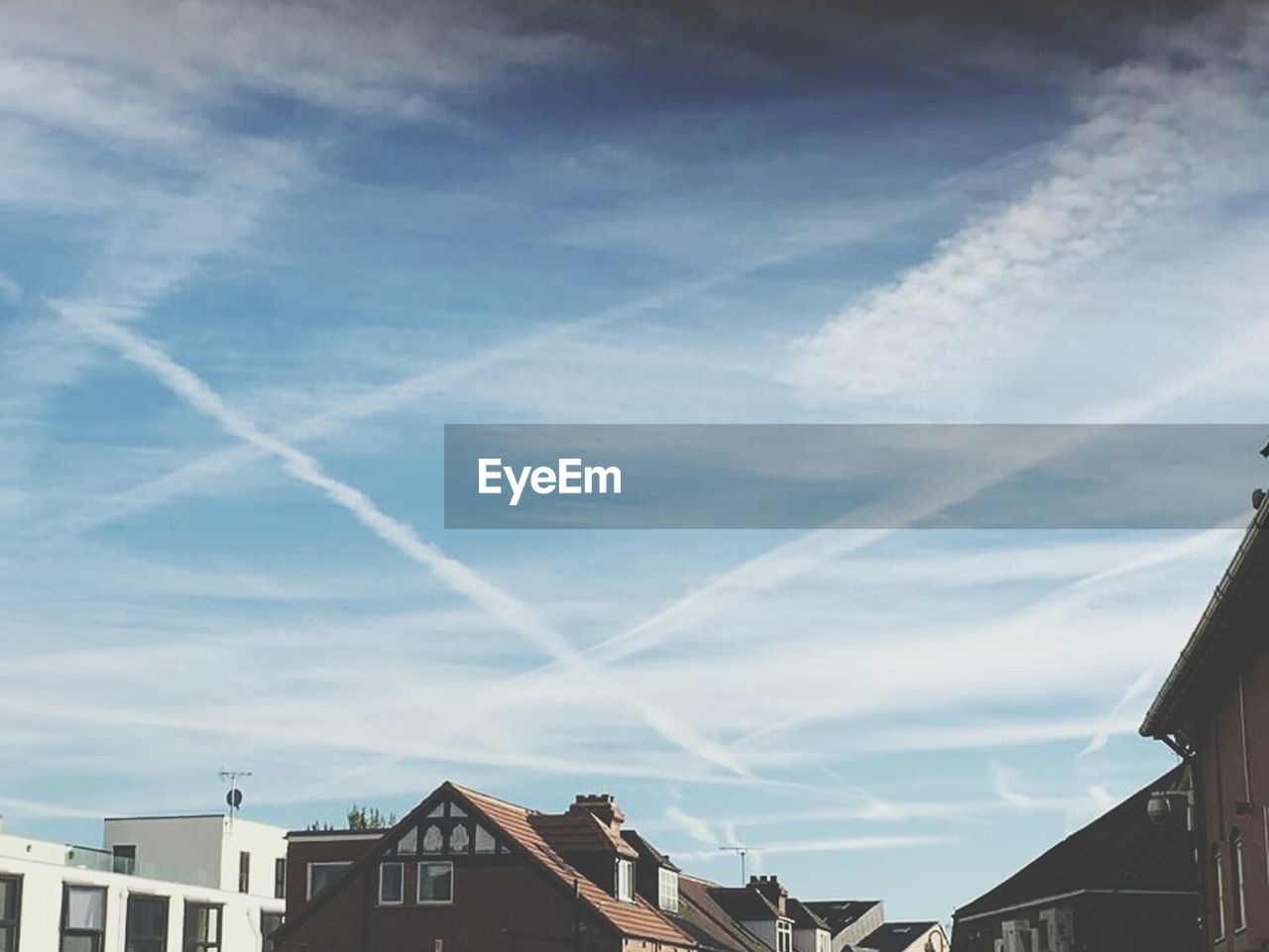 architecture, building exterior, built structure, house, day, no people, sky, outdoors, vapor trail, roof, low angle view, nature, contrail