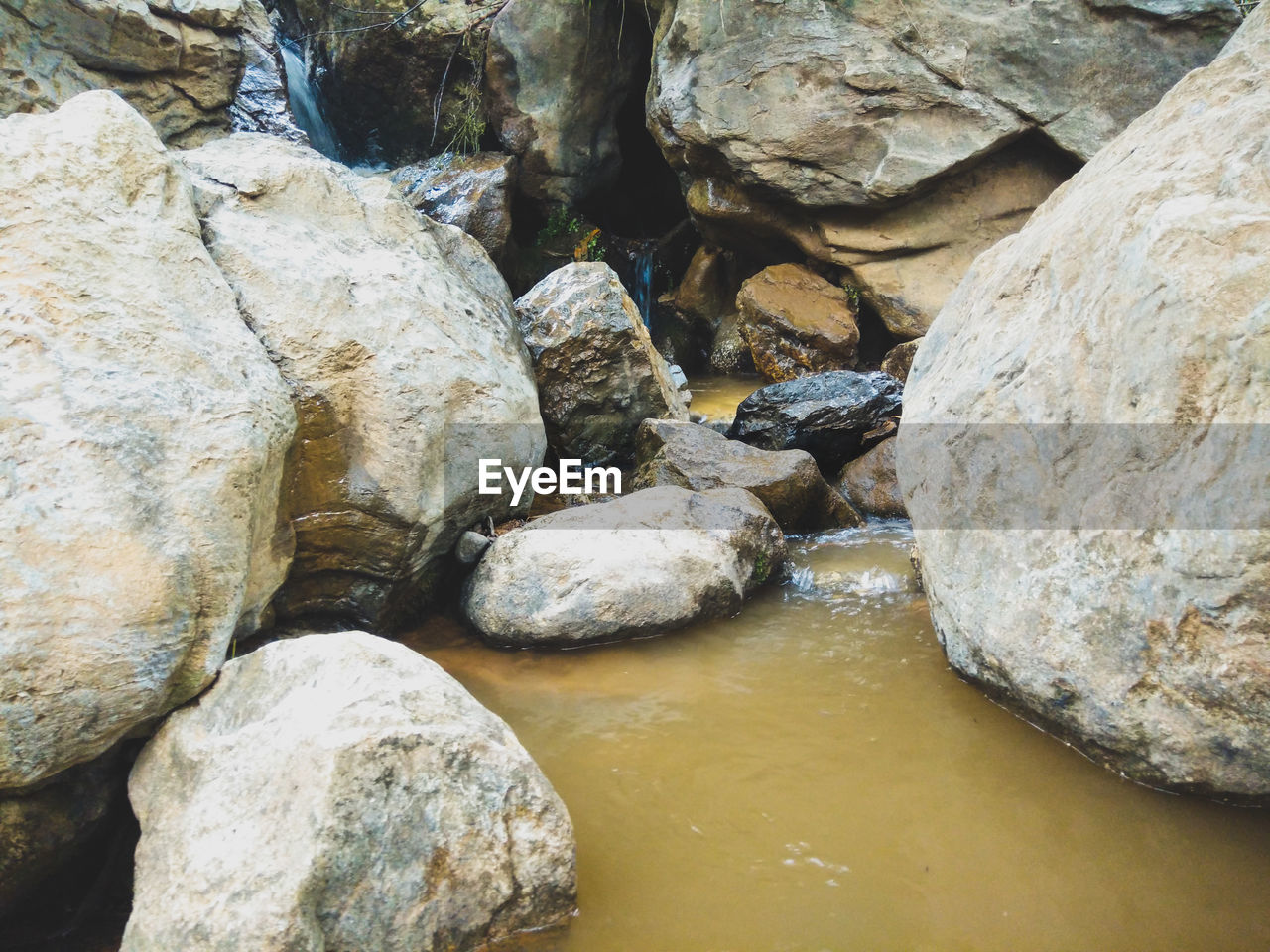 rock - object, rock formation, nature, water, no people, outdoors, day, tranquility, beauty in nature, scenics