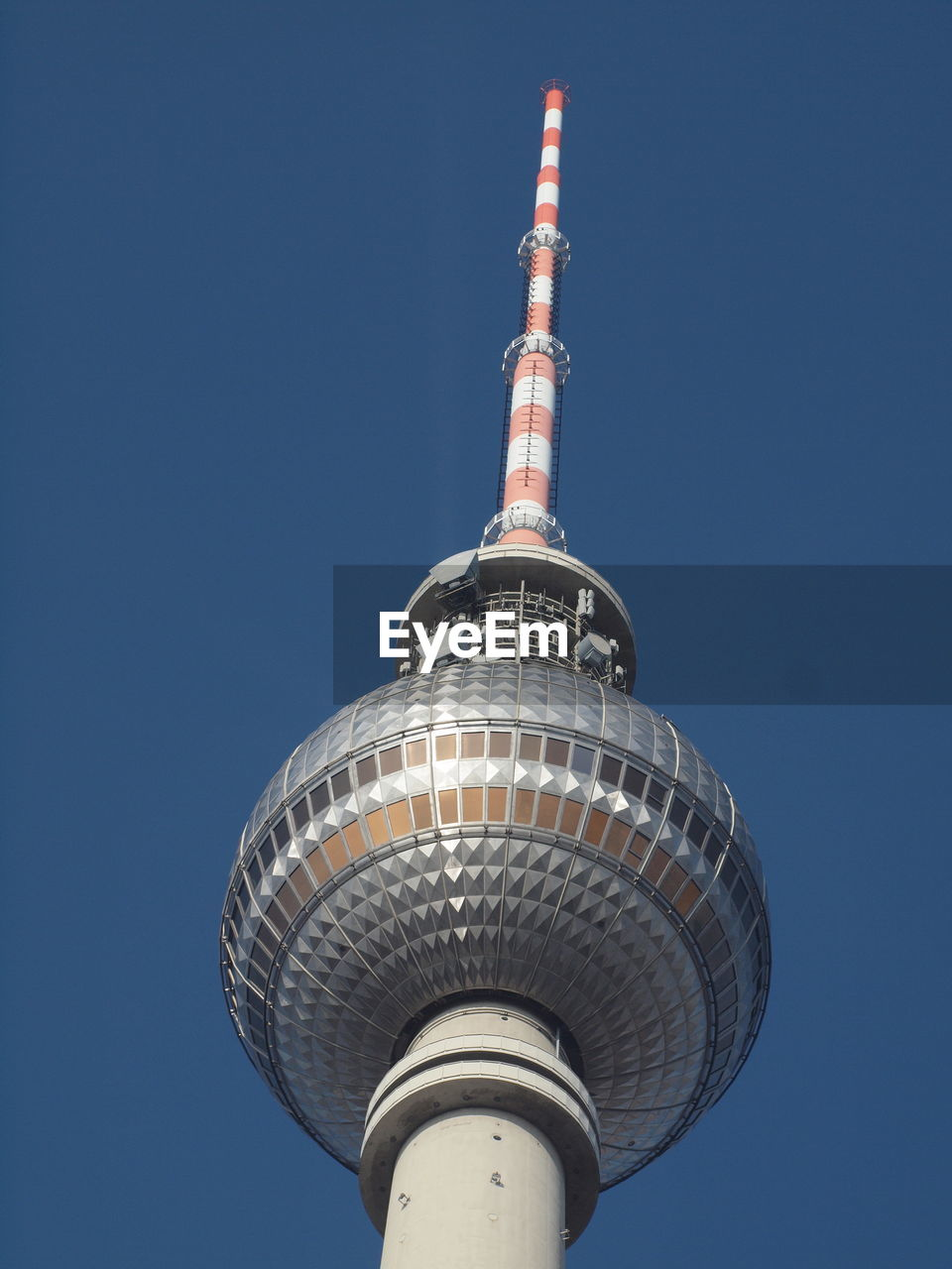 architecture, tall - high, tower, communication, clear sky, built structure, building exterior, travel destinations, blue, low angle view, television tower, outdoors, no people, travel, city, day, skyscraper, sky