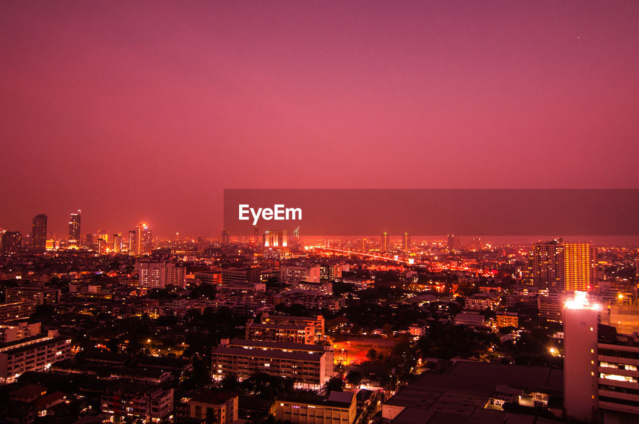building exterior, city, cityscape, built structure, architecture, building, sky, illuminated, nature, night, no people, residential district, outdoors, copy space, modern, high angle view, office building exterior, skyscraper, location, neighborhood, place