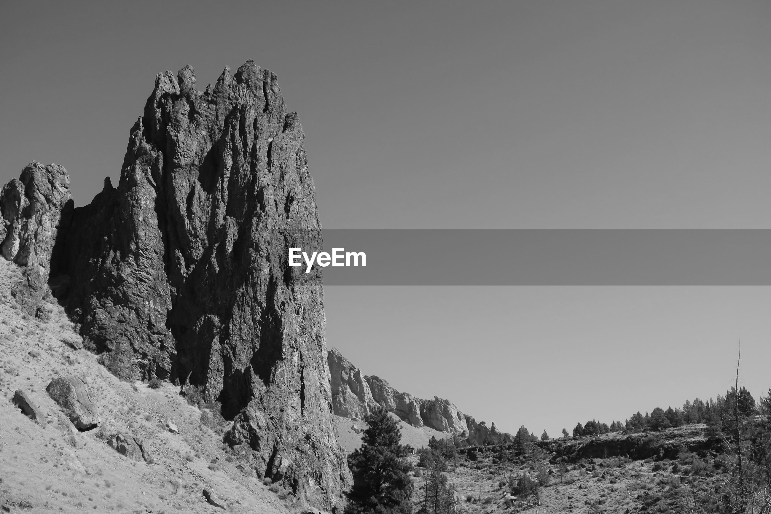 Low angle black and white landscape of vertical rock formations at smith rock state park