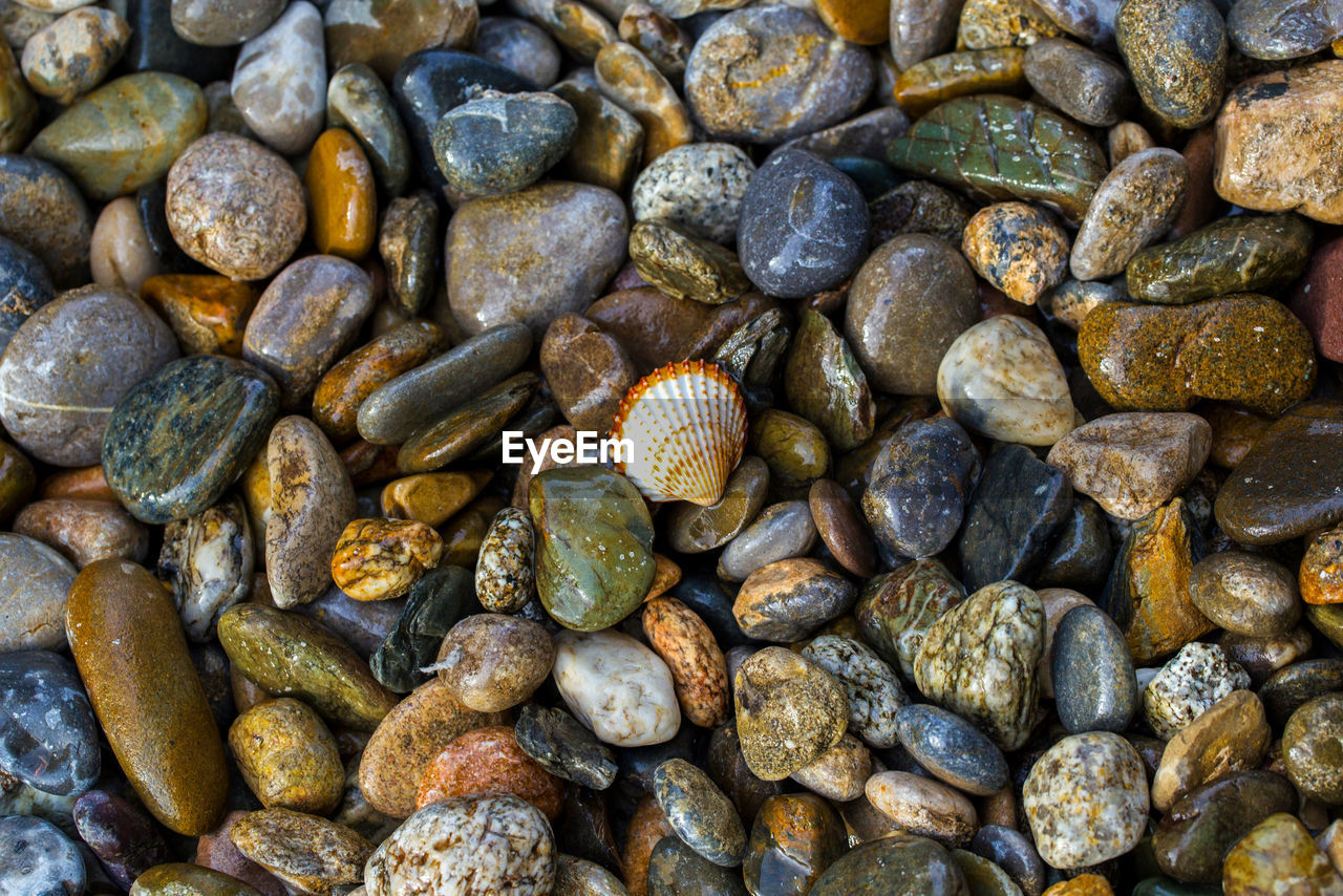 full frame, large group of objects, solid, backgrounds, rock, pebble, abundance, stone - object, no people, stone, nature, day, high angle view, rock - object, close-up, beach, directly above, outdoors, textured, land