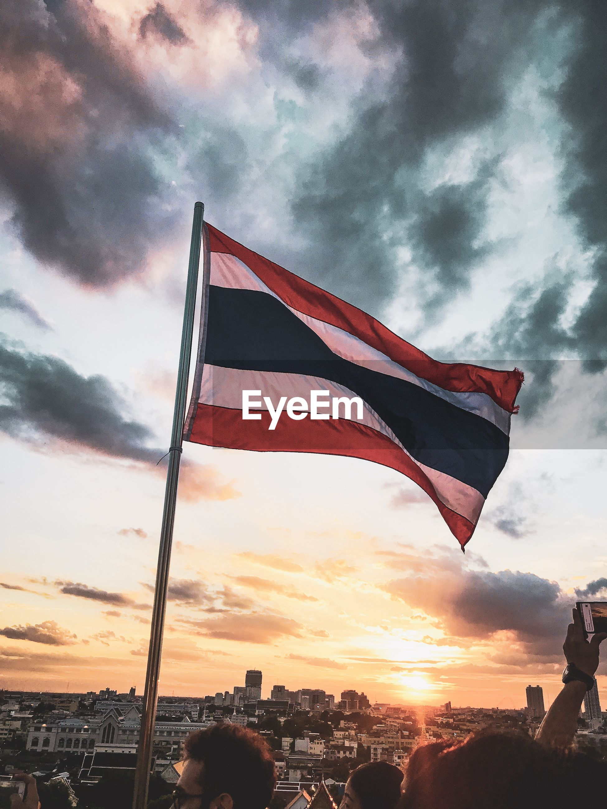 Low angle view of flag against sky during sunset