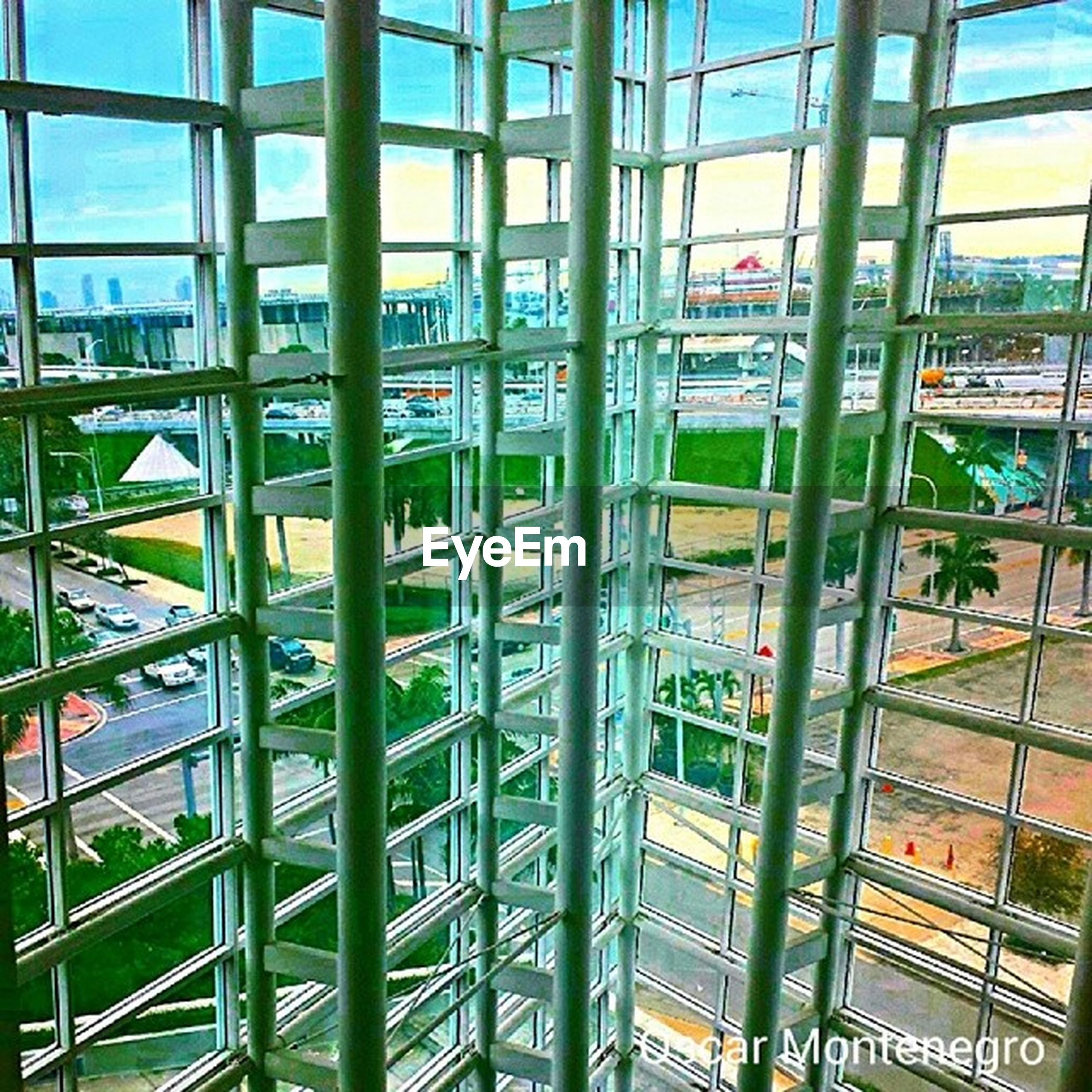 built structure, architecture, metal, glass - material, indoors, pattern, railing, metallic, modern, day, grid, transparent, sky, window, blue, building exterior, fence, sunlight, no people, full frame