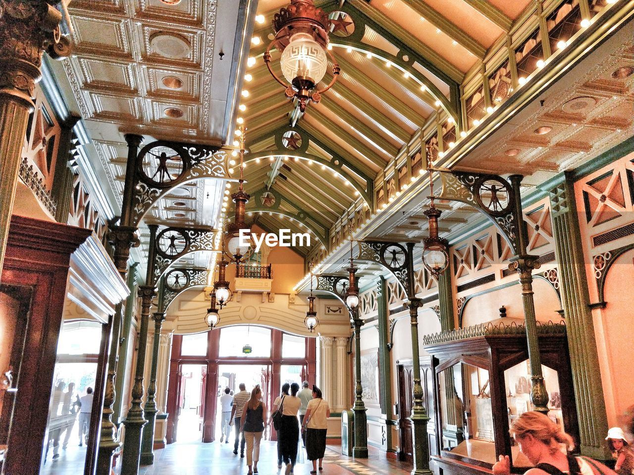 group of people, architecture, ceiling, indoors, built structure, lighting equipment, women, real people, walking, men, travel destinations, adult, incidental people, travel, lifestyles, architectural column, shopping mall, day, hanging, shopping, ornate, consumerism, luxury