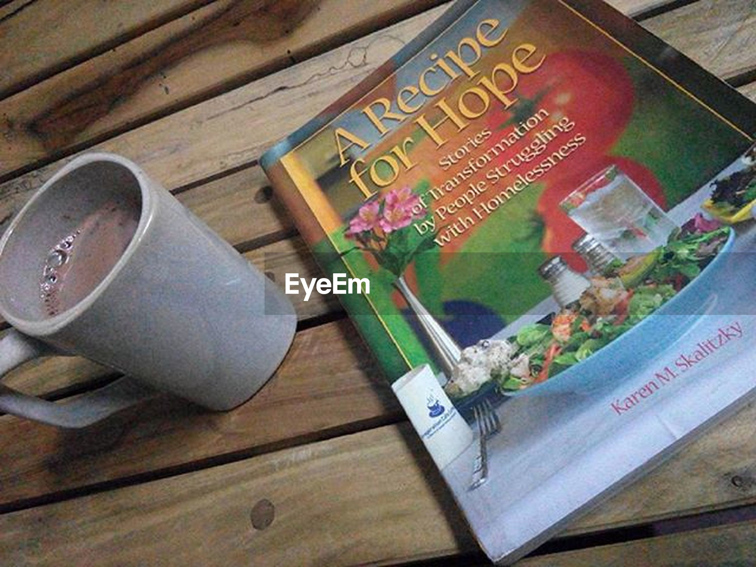 indoors, table, text, still life, wood - material, communication, western script, high angle view, food and drink, book, wooden, freshness, close-up, education, paper, no people, wood, variation, non-western script, selective focus