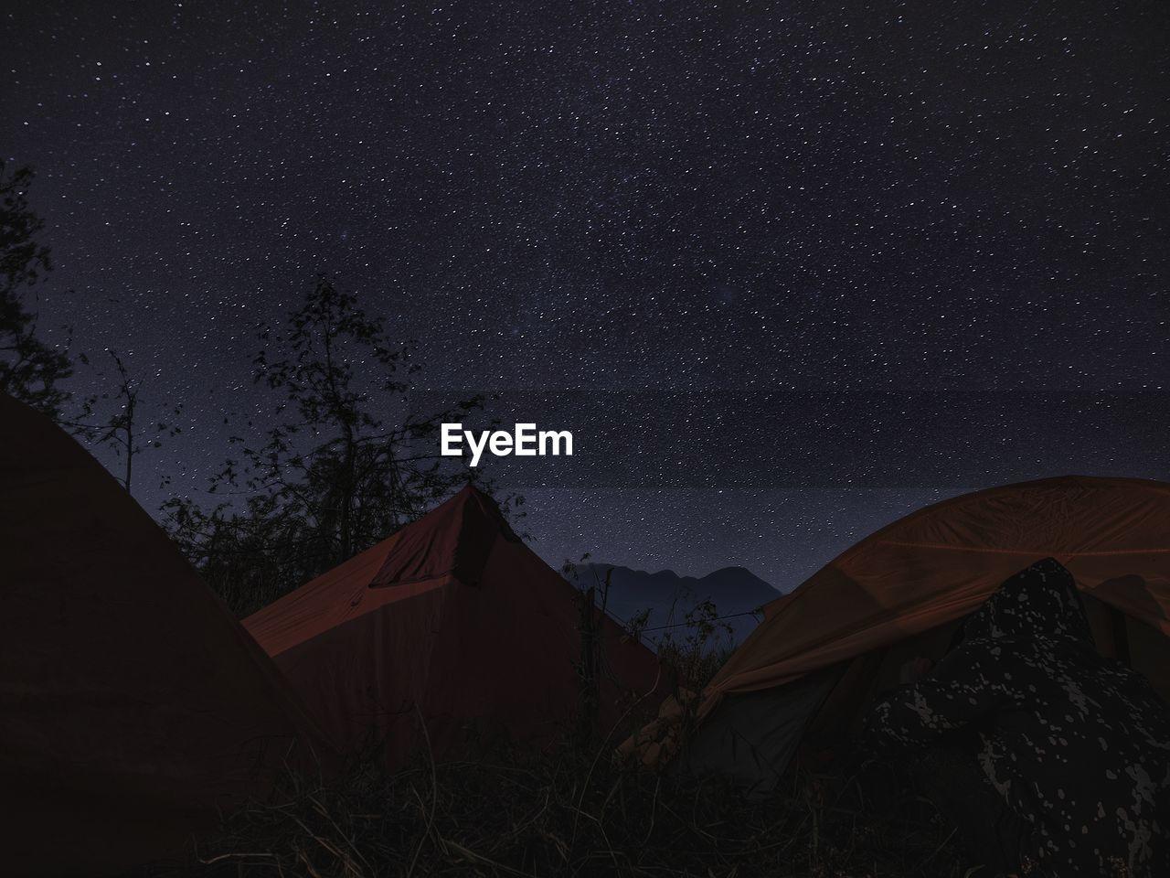 Camping on the mountain peak among sky full of stars