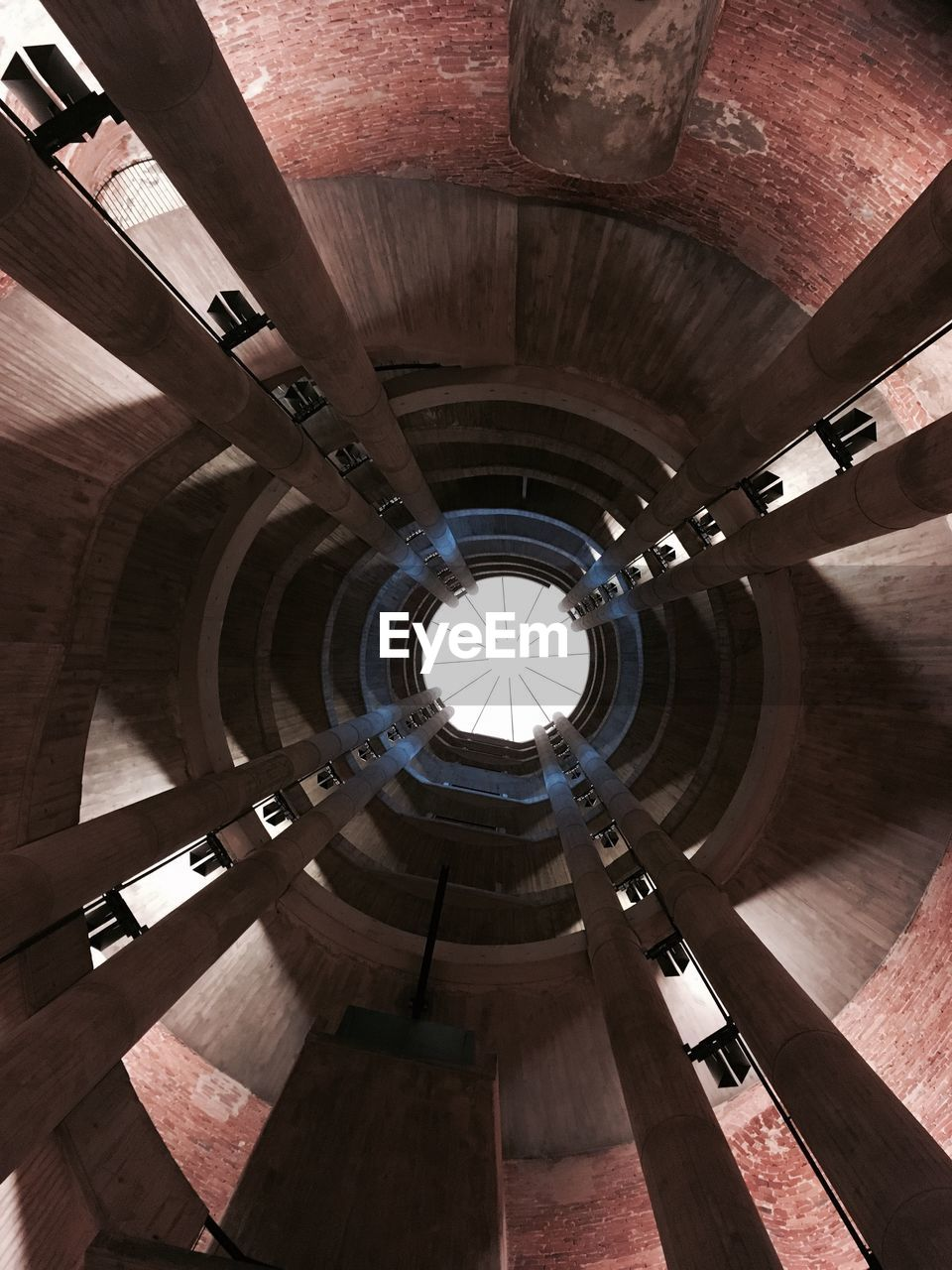 HIGH ANGLE VIEW OF SPIRAL STAIRCASE IN CORRIDOR