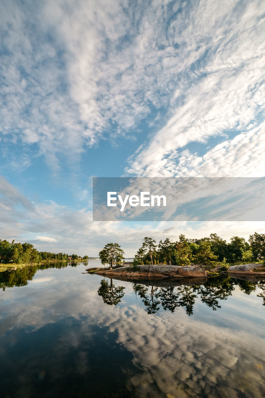 sky, cloud - sky, water, reflection, tranquility, tranquil scene, beauty in nature, lake, scenics - nature, tree, nature, no people, plant, waterfront, idyllic, outdoors, day, non-urban scene, standing water
