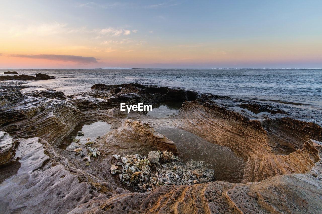 sky, sunset, water, sea, beauty in nature, scenics - nature, horizon over water, beach, horizon, rock, land, solid, rock - object, tranquil scene, tranquility, cloud - sky, nature, idyllic, non-urban scene, no people, rocky coastline