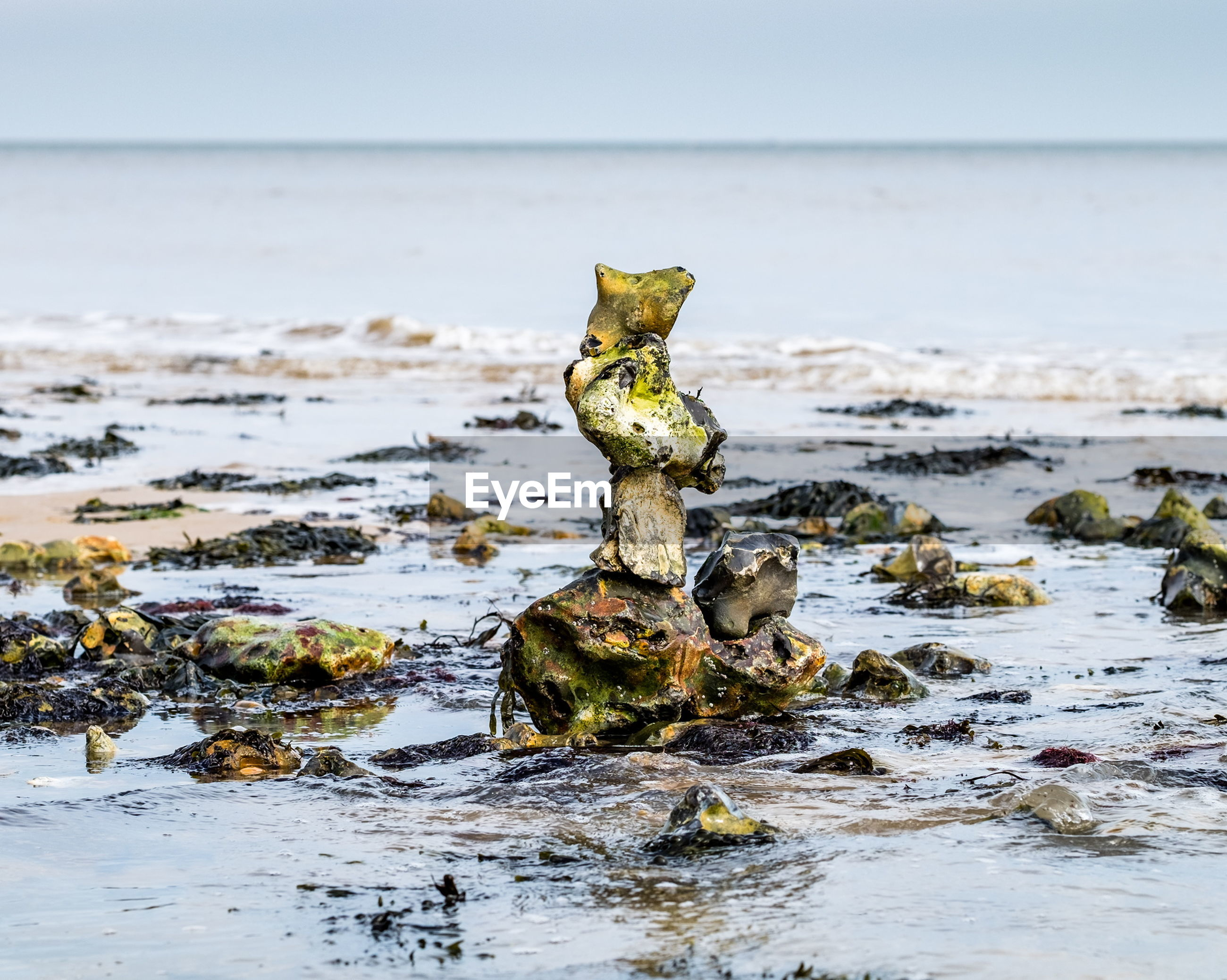 Stack of rocks on shore in sea