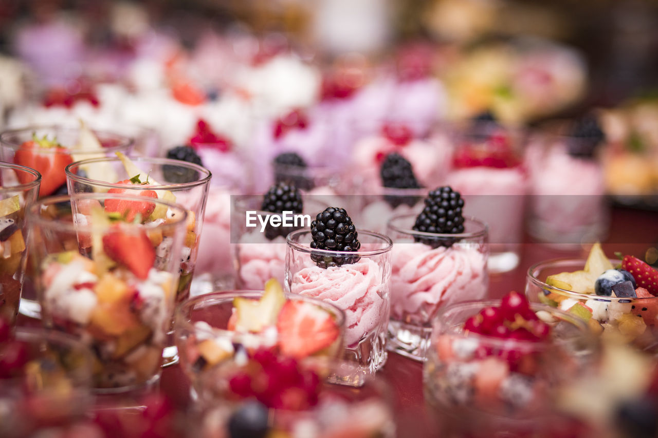 Close-Up Of Desserts In Glasses On Table