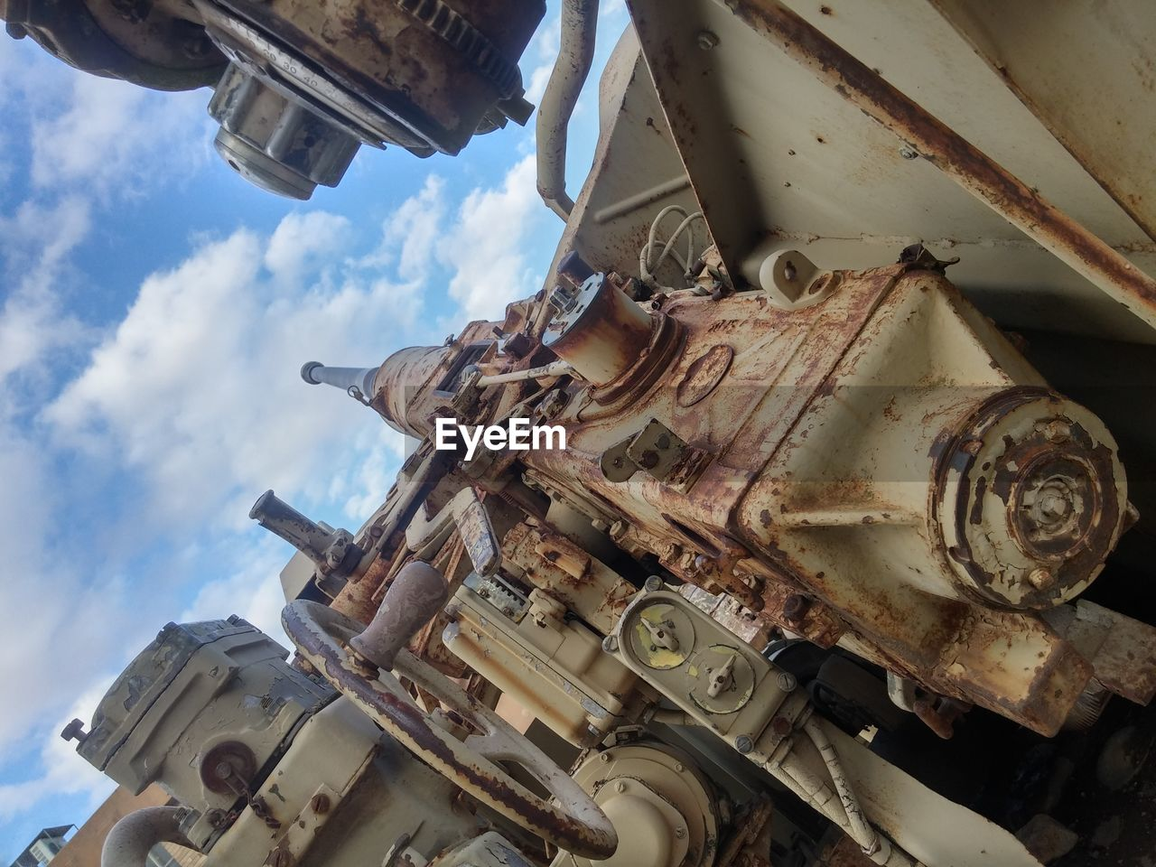 sky, cloud - sky, no people, low angle view, history, mode of transport, day, outdoors, machinery, transportation, military
