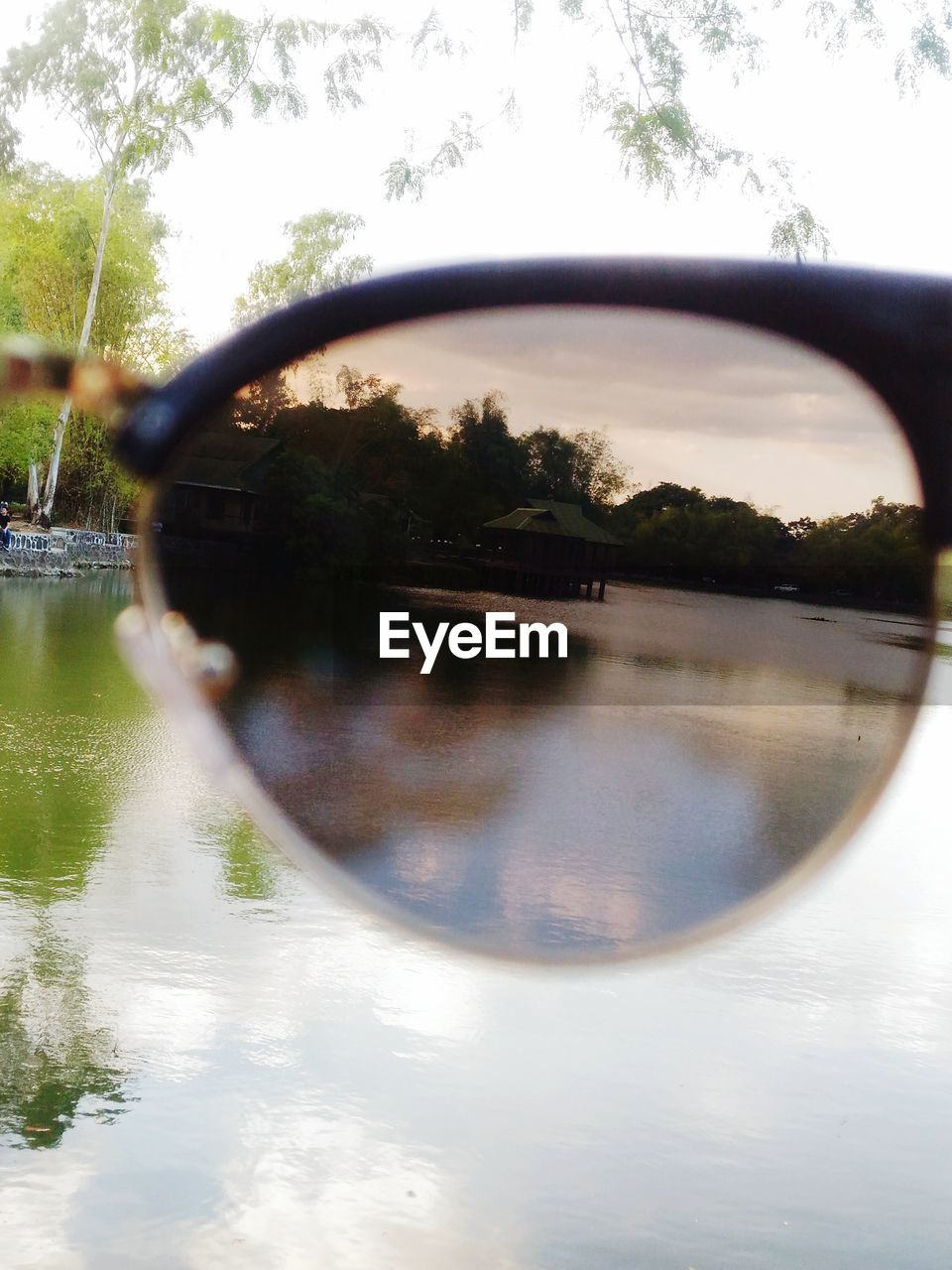 reflection, sunglasses, water, tree, side-view mirror, day, sky, eyeglasses, outdoors, no people, grass, nature, eyesight, fish-eye lens, building exterior, close-up