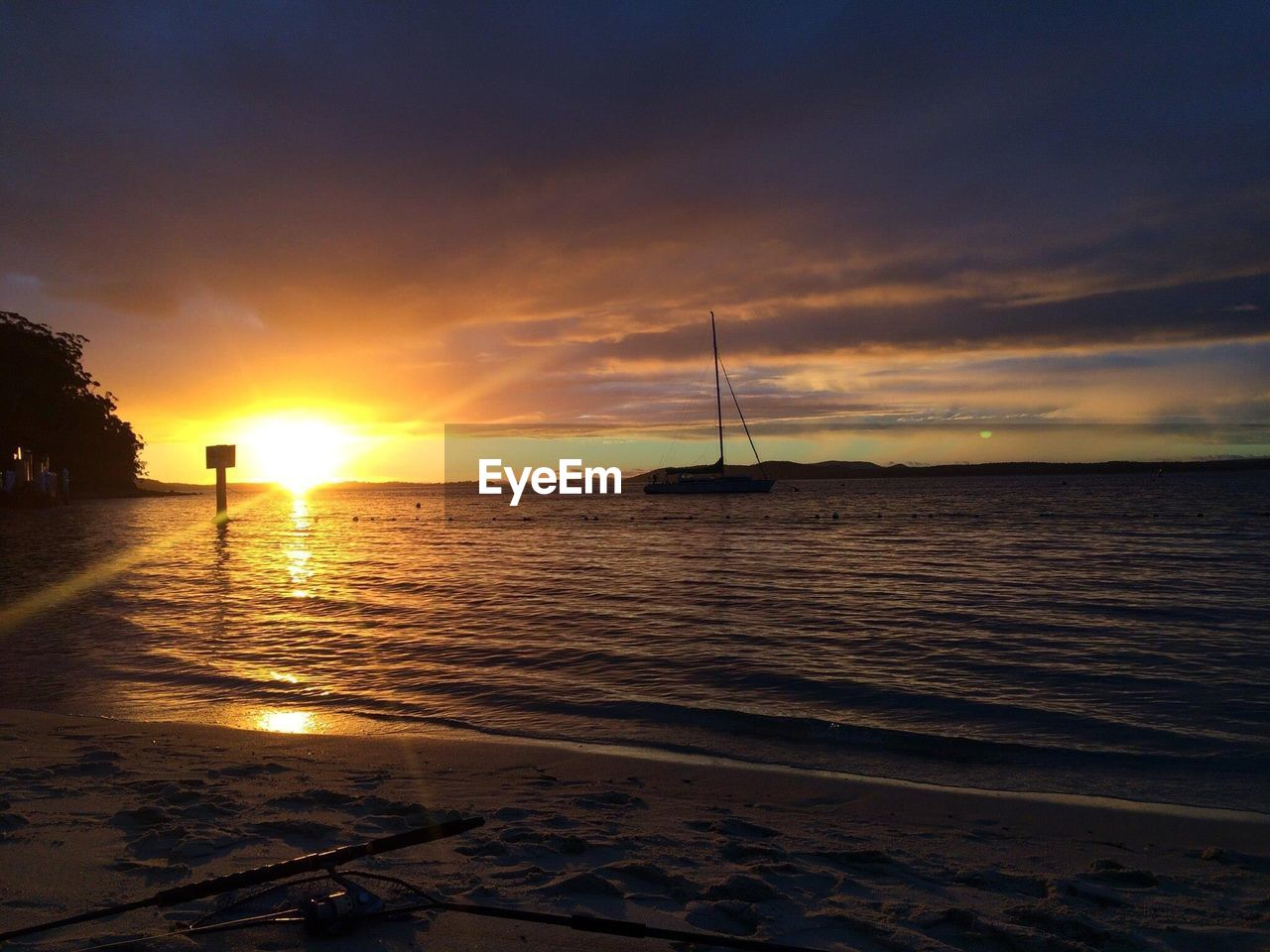 sunset, sea, water, sky, scenics, beauty in nature, nature, nautical vessel, sun, tranquil scene, tranquility, outdoors, sailboat, no people, cloud - sky, reflection, transportation, beach, sunlight, horizon over water, yacht, mast, sailing