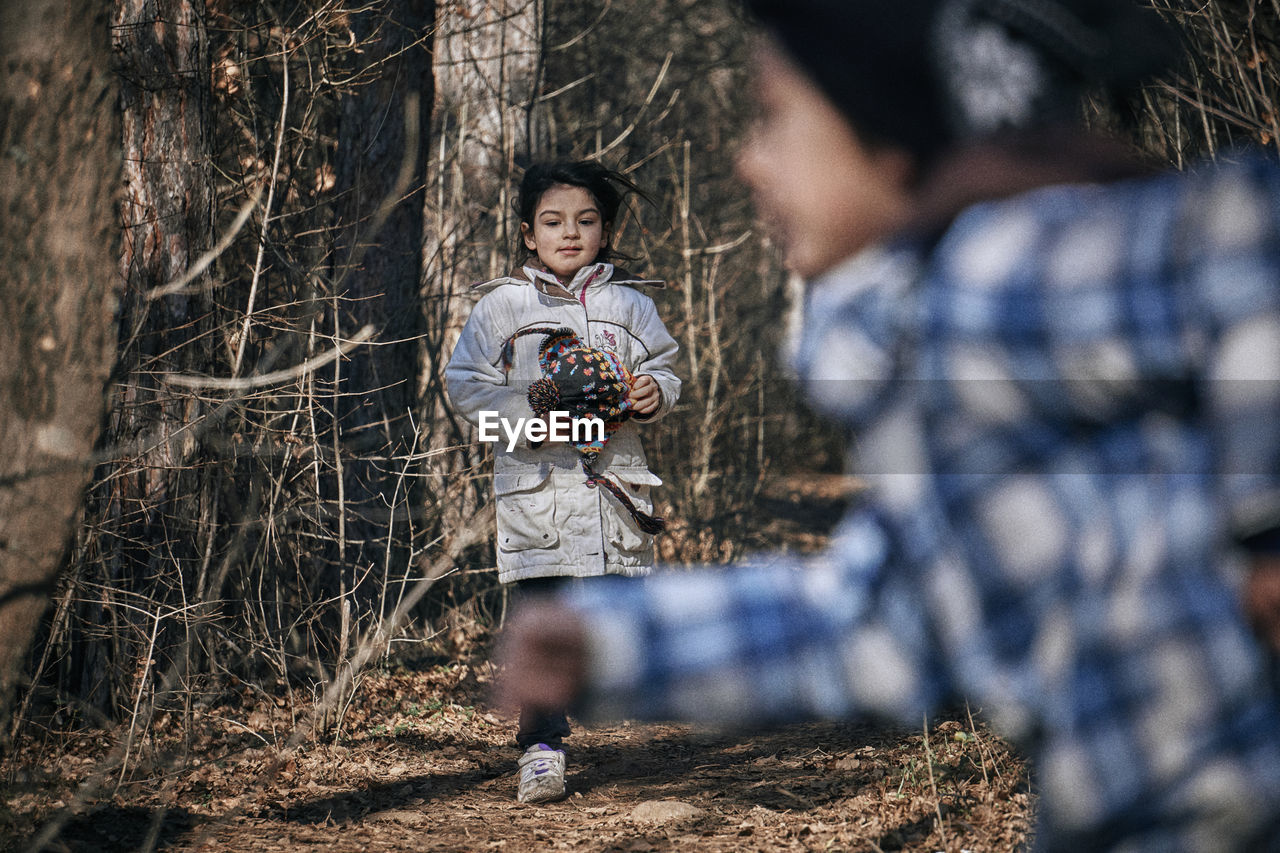 Girl With Sister Running In Forest