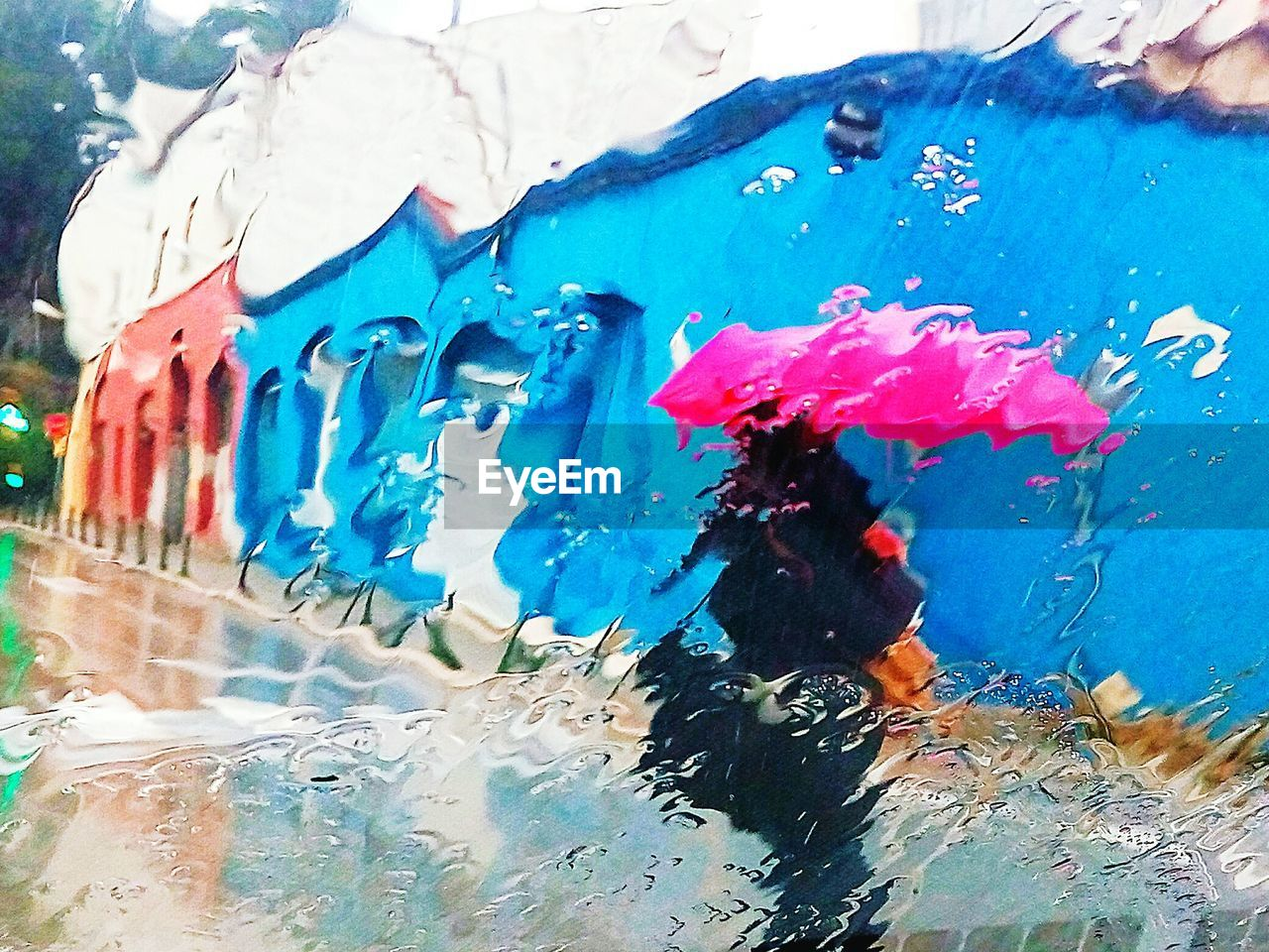 water, day, real people, outdoors, swimming pool, blue, multi colored, one person, architecture, close-up