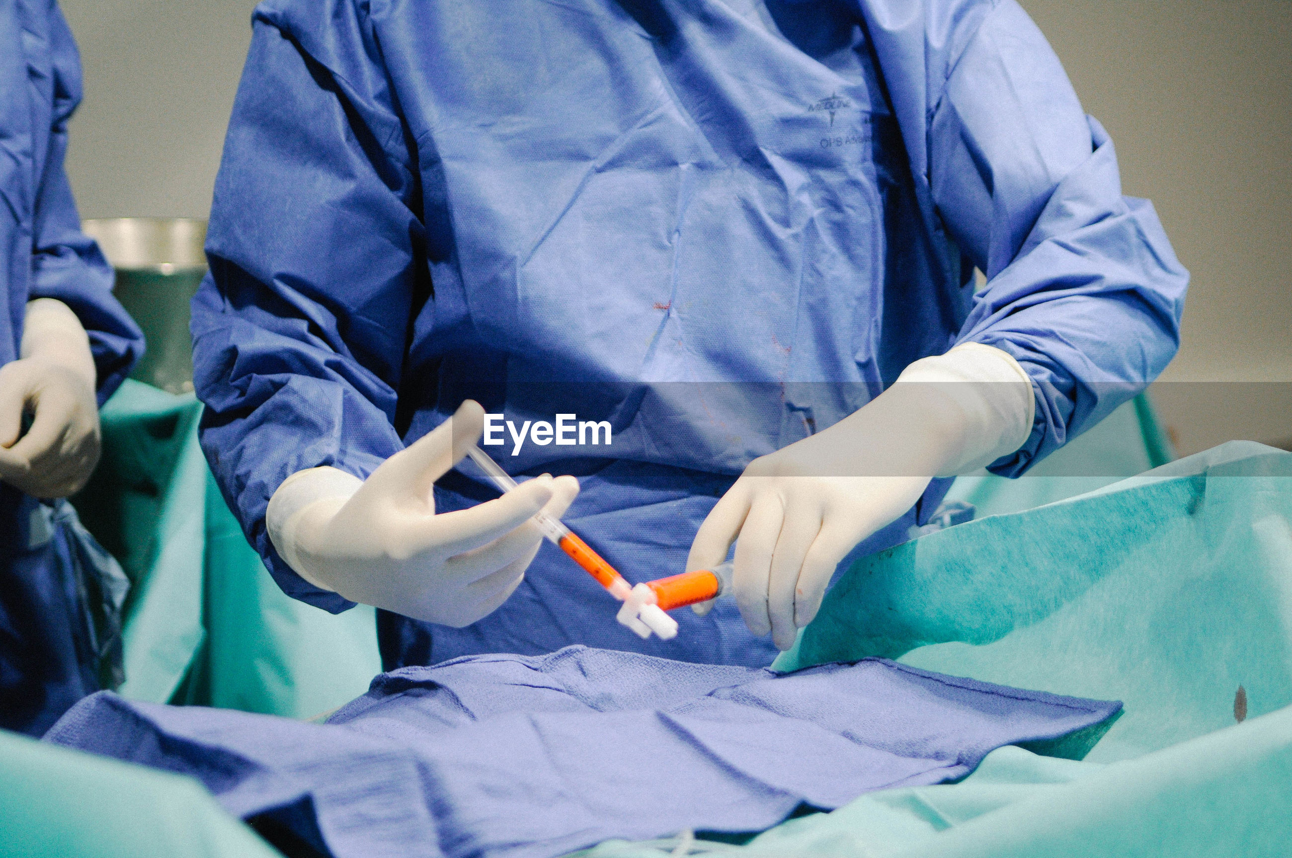 Midsection of surgeons in operating room at hospital