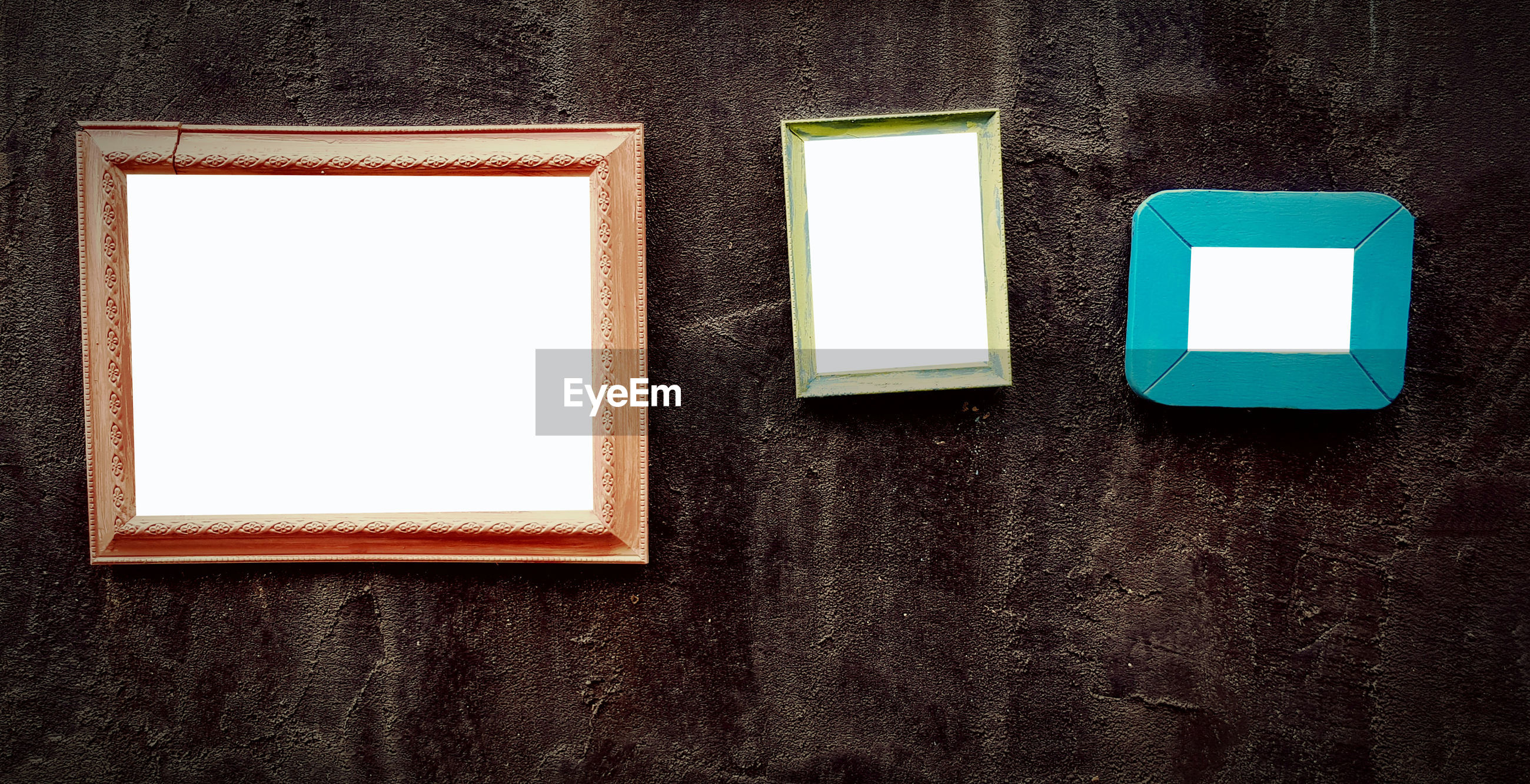 Low angle view of empty pictureframe hanging on wall