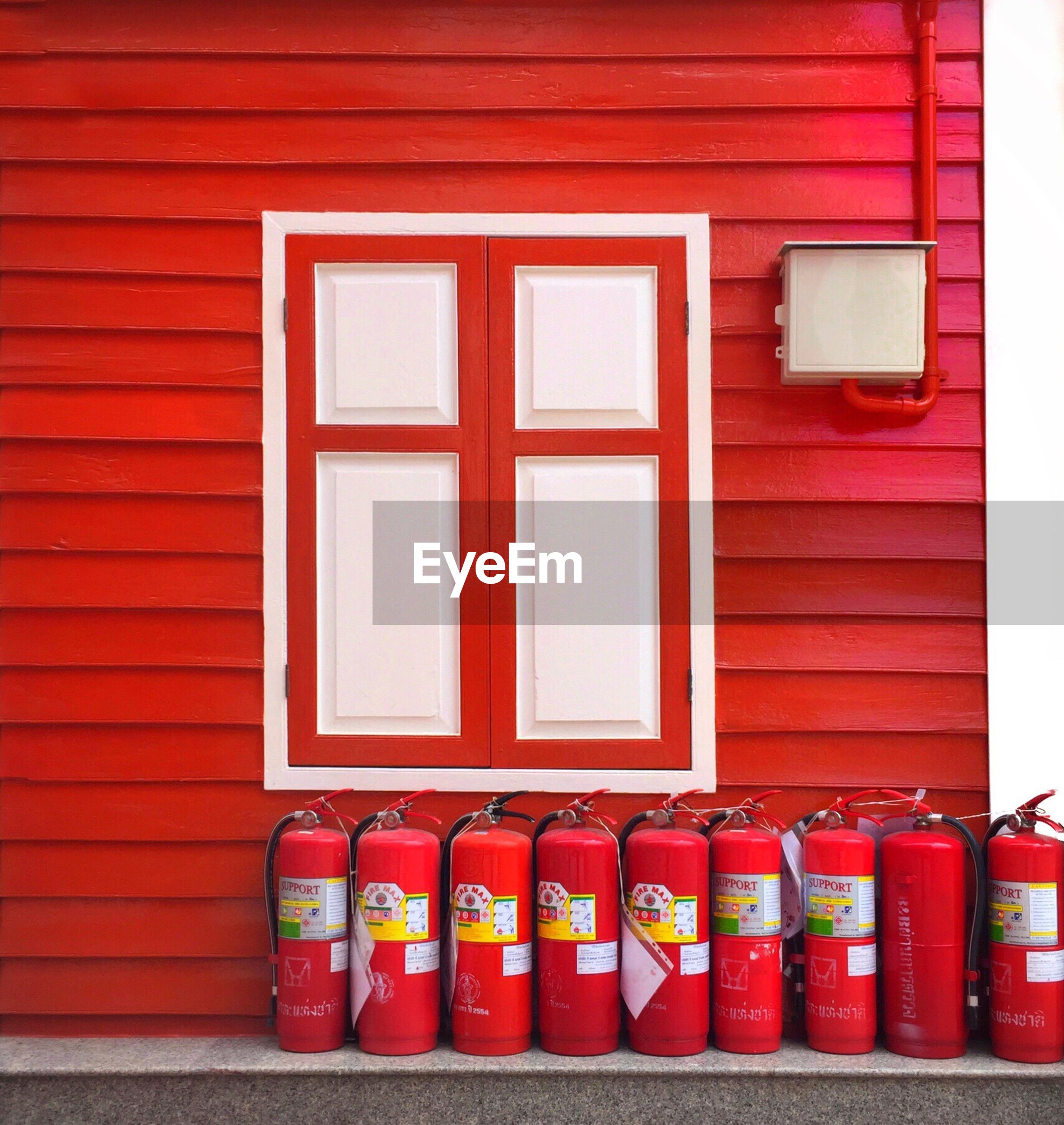 Fire extinguishers on retaining wall by