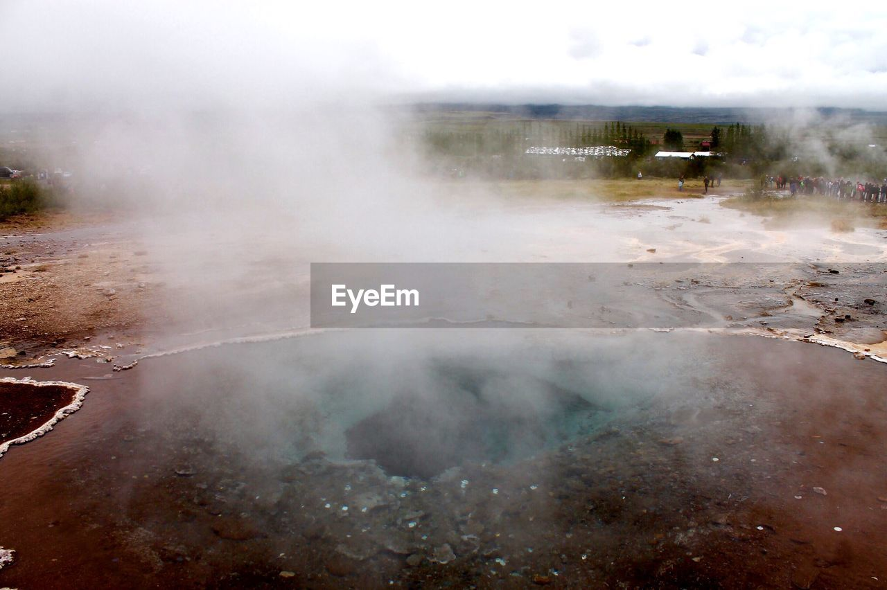 steam, smoke - physical structure, geyser, hot spring, geology, heat - temperature, nature, day, no people, landscape, outdoors, volcanic landscape, physical geography, beauty in nature, erupting, power in nature, water, scenics, sky, close-up