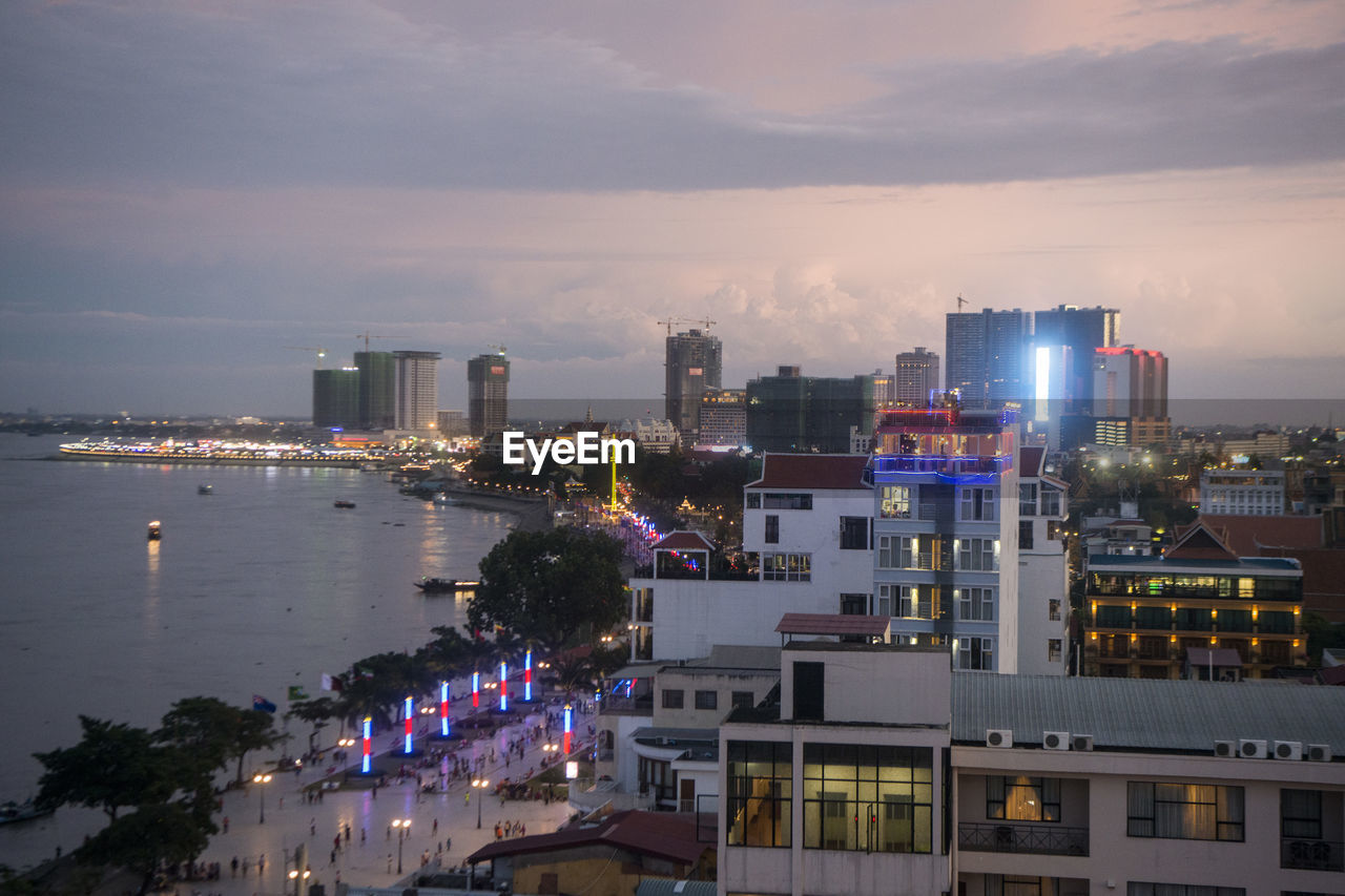 building exterior, built structure, architecture, sky, city, cloud - sky, illuminated, water, nature, building, cityscape, no people, high angle view, night, outdoors, dusk, office building exterior, reflection, modern, skyscraper, bay