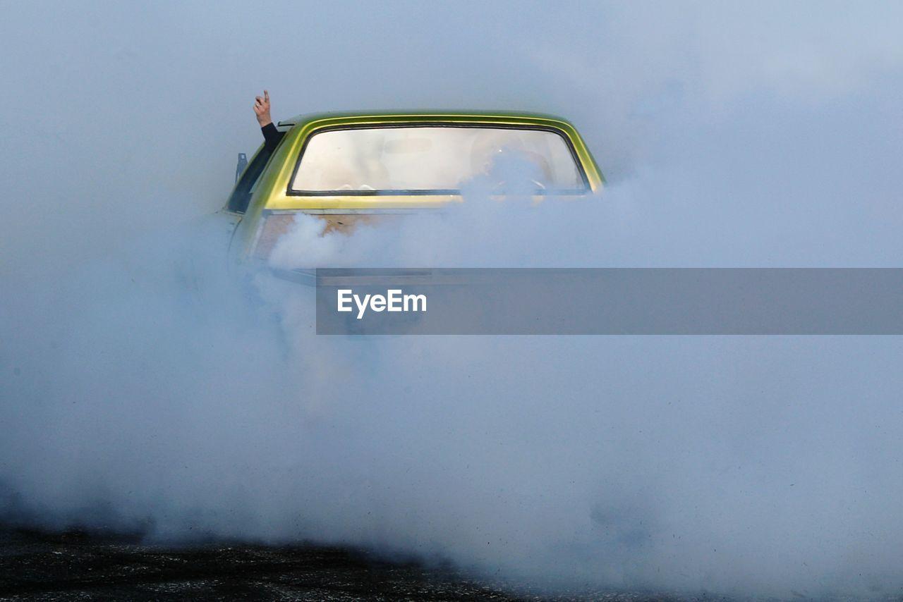 Car Releasing Smoke On Road