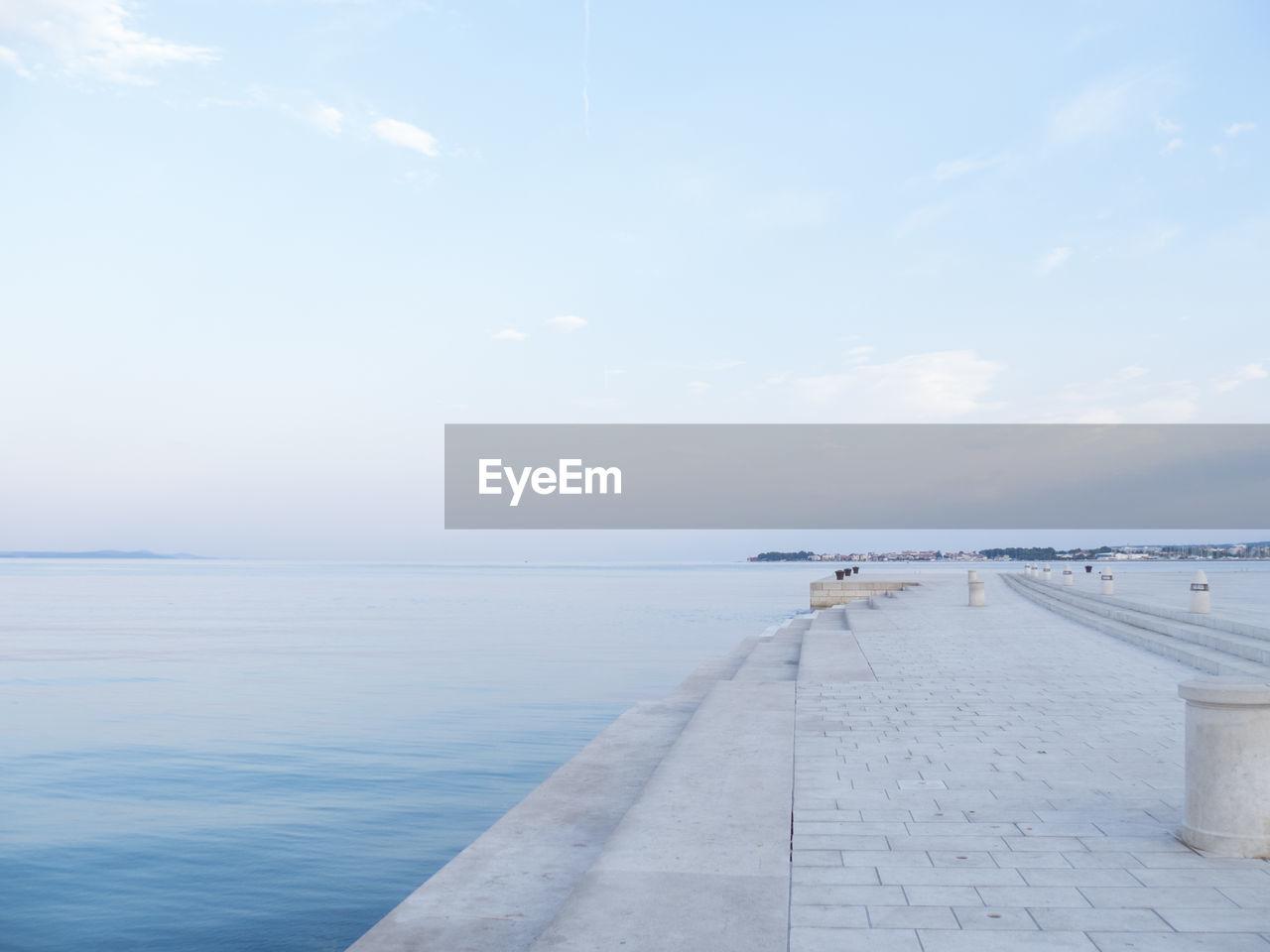 EMPTY JETTY ALONG CALM SEA