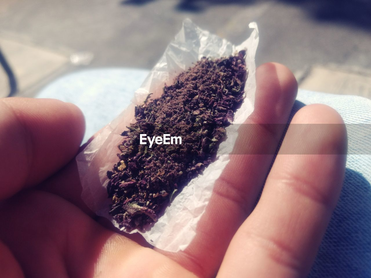 human hand, human body part, one person, human finger, real people, holding, unrecognizable person, lifestyles, close-up, bad habit, focus on foreground, addiction, women, indoors, marijuana - herbal cannabis, food, day, people