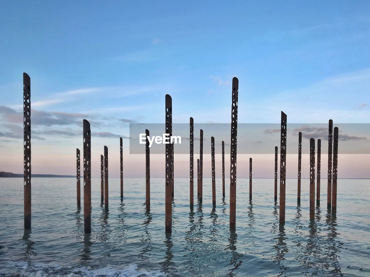 sky, wooden post, nature, post, no people, wood - material, water, beauty in nature, sea, day, waterfront, cloud - sky, tranquility, outdoors, scenics - nature, focus on foreground, tranquil scene, blue, architecture
