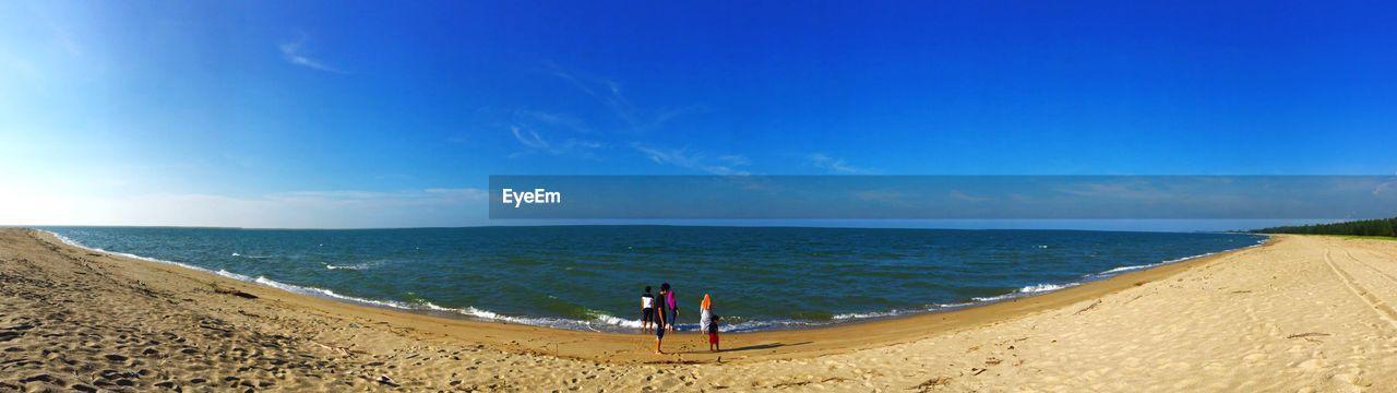 Panoramic shot of beach against blue sky