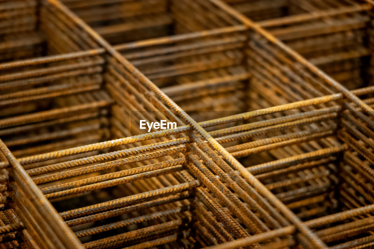 backgrounds, full frame, no people, close-up, wood - material, pattern, brown, selective focus, rod, large group of objects, indoors, day, focus on foreground, textured, stack, rusty, still life, metal, abundance, crisscross, construction equipment