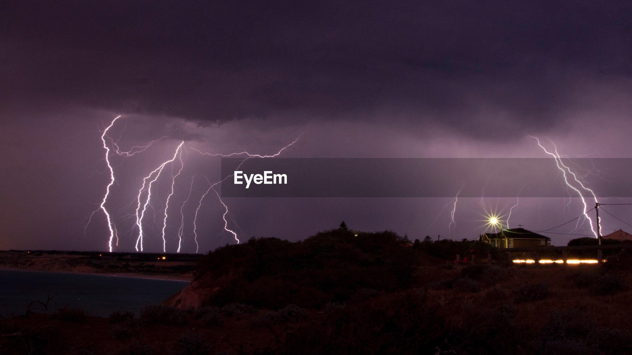 LIGHTNING IN SKY OVER LANDSCAPE