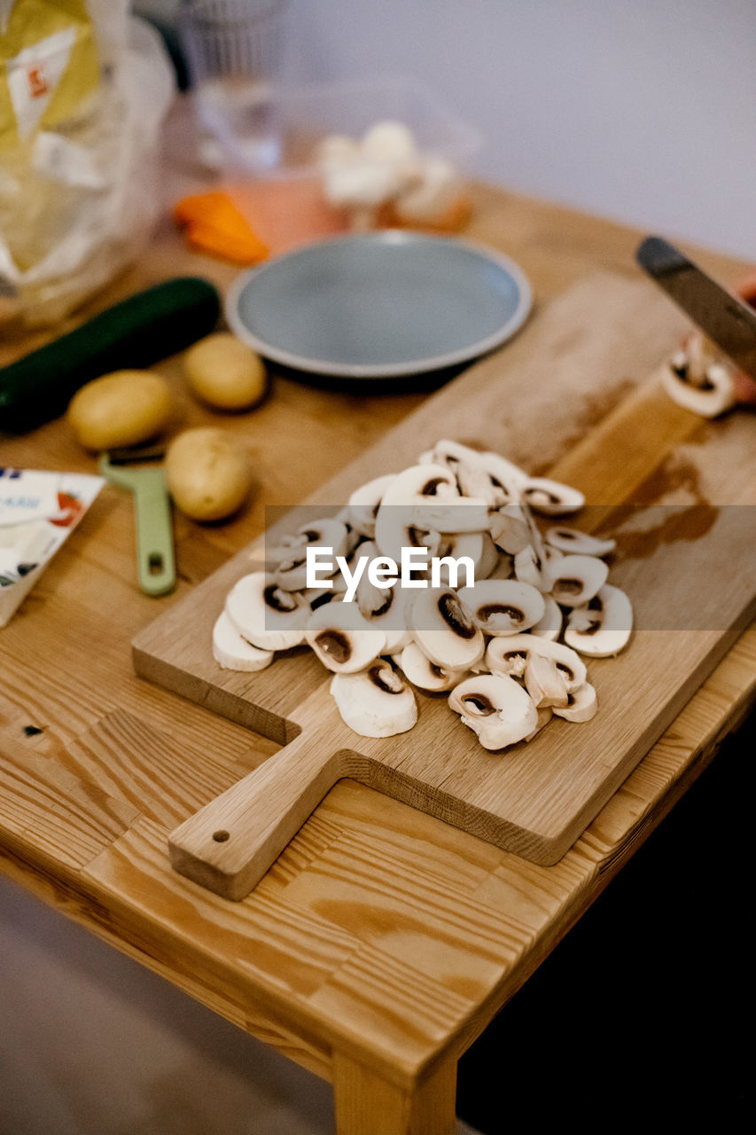 food, food and drink, freshness, still life, cutting board, table, healthy eating, high angle view, indoors, wellbeing, wood - material, no people, preparation, raw food, fruit, vegetable, focus on foreground, close-up, kitchen utensil, cheese