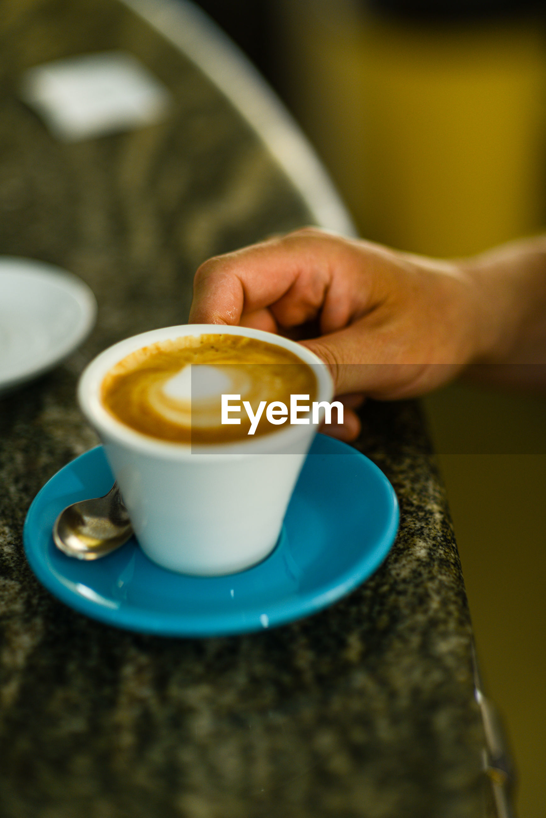 CROPPED IMAGE OF COFFEE CUP WITH TEA