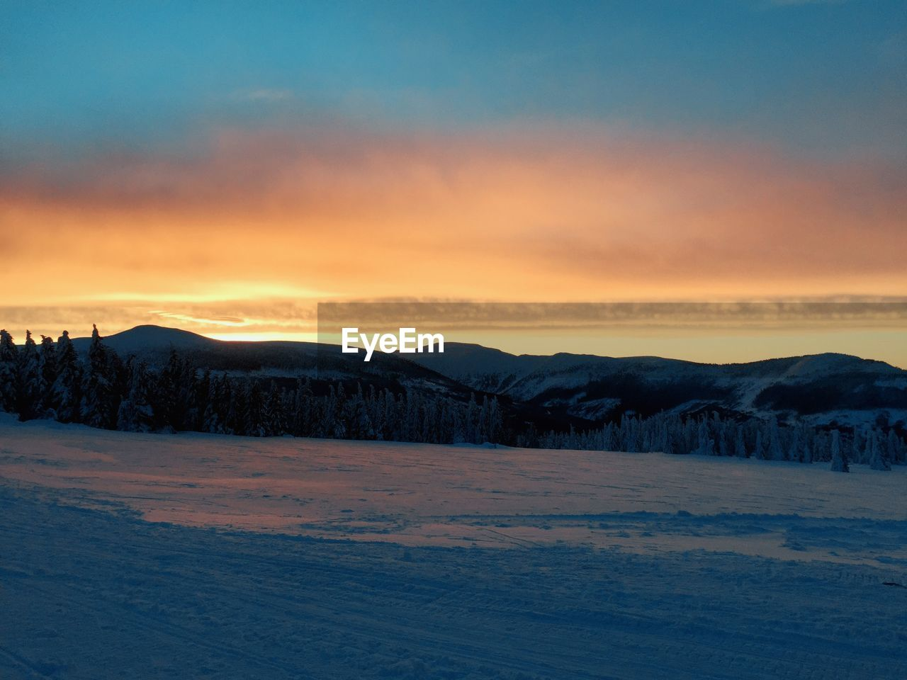 snow, cold temperature, winter, sunset, beauty in nature, scenics - nature, sky, tranquil scene, tranquility, cloud - sky, environment, landscape, mountain, nature, no people, orange color, non-urban scene, idyllic, land, outdoors, snowcapped mountain