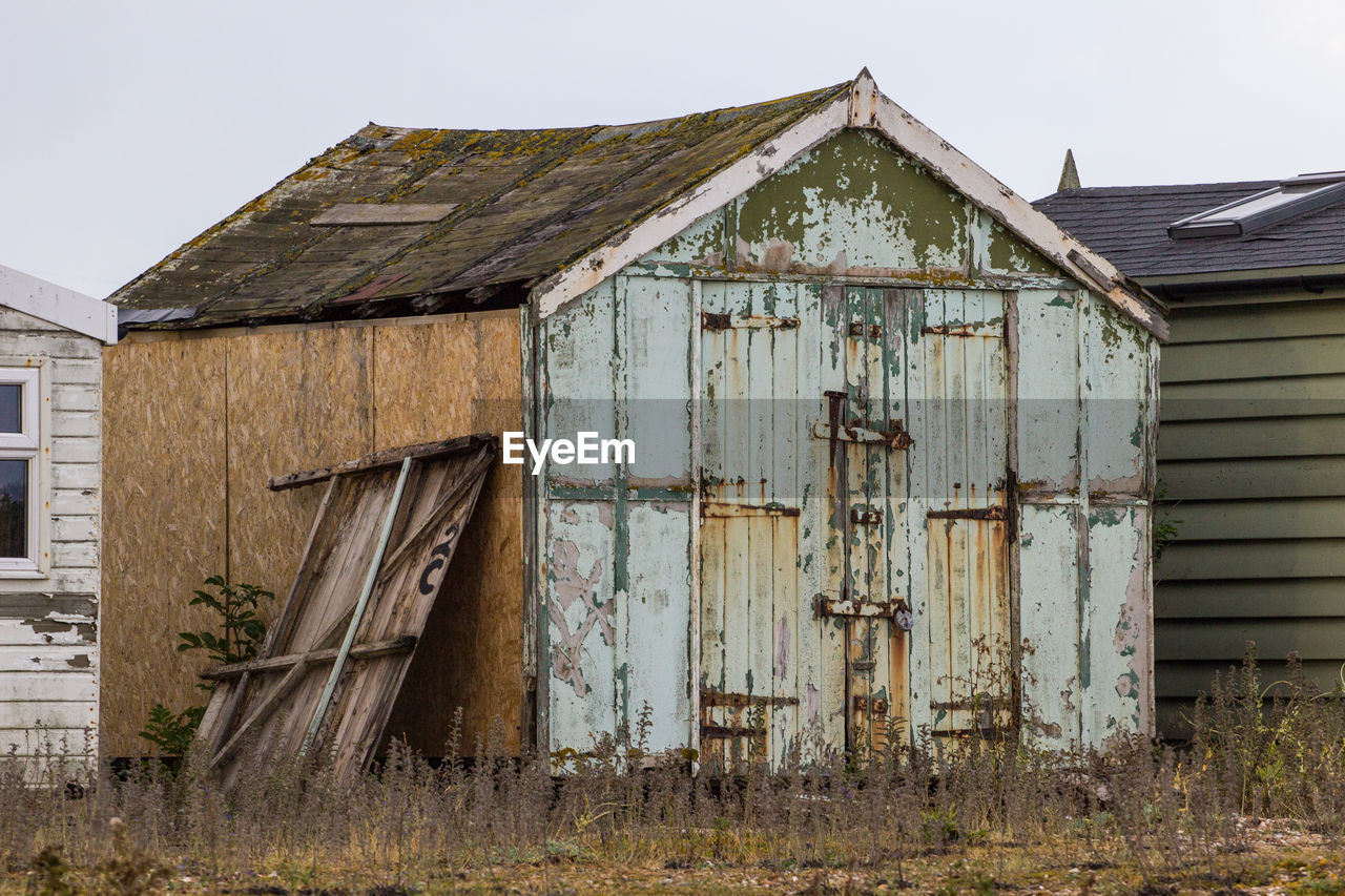 built structure, architecture, building exterior, building, wood - material, house, abandoned, no people, day, old, sky, nature, damaged, field, agricultural building, land, barn, outdoors, obsolete, residential district, deterioration