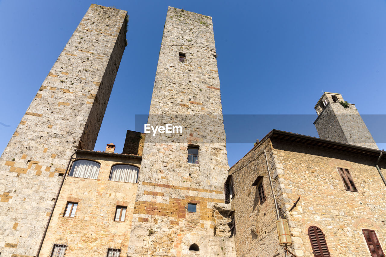 architecture, building exterior, built structure, building, low angle view, history, sky, the past, clear sky, window, blue, nature, sunlight, day, old, no people, city, tower, travel destinations, outdoors