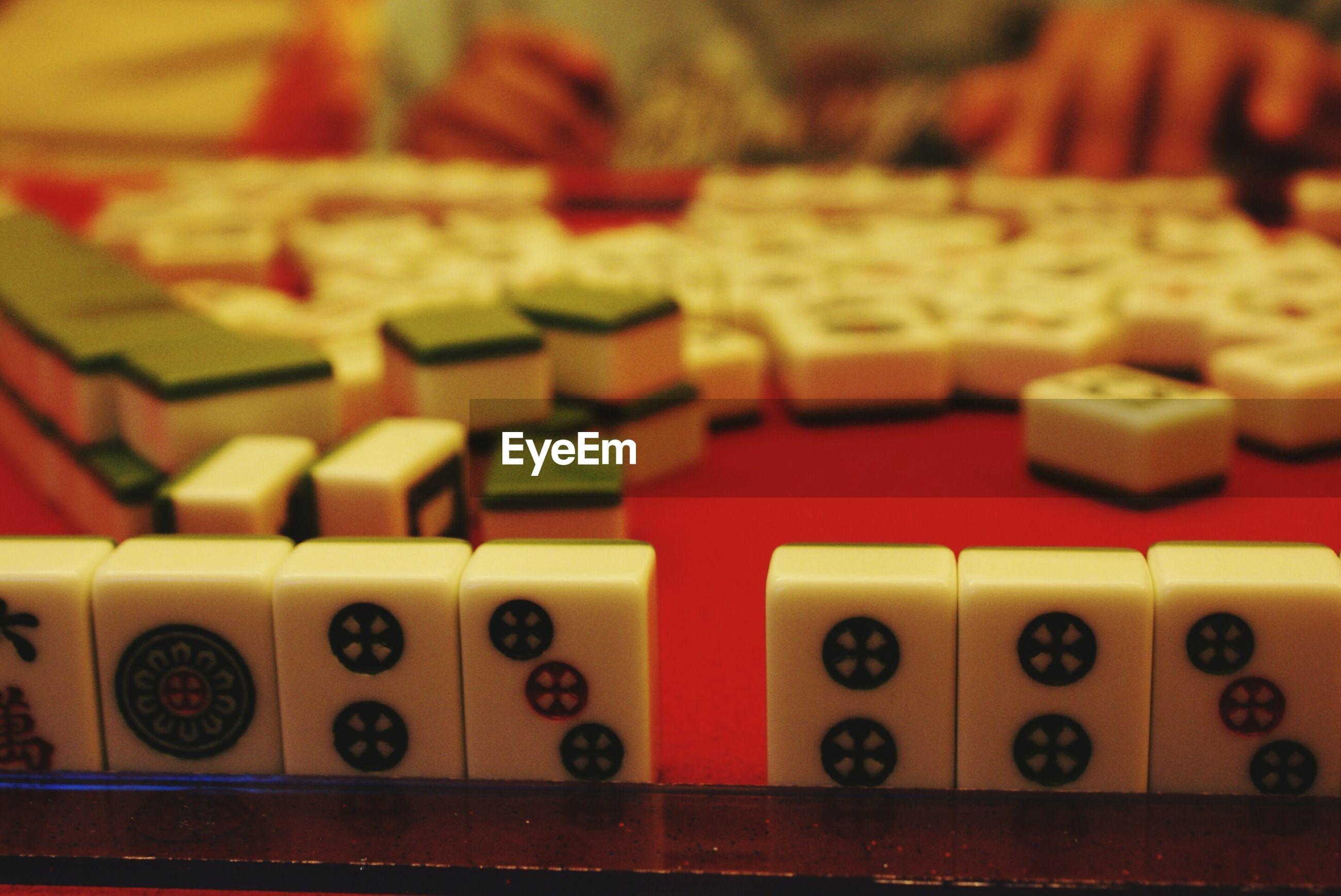 Midsection of man playing mahjong