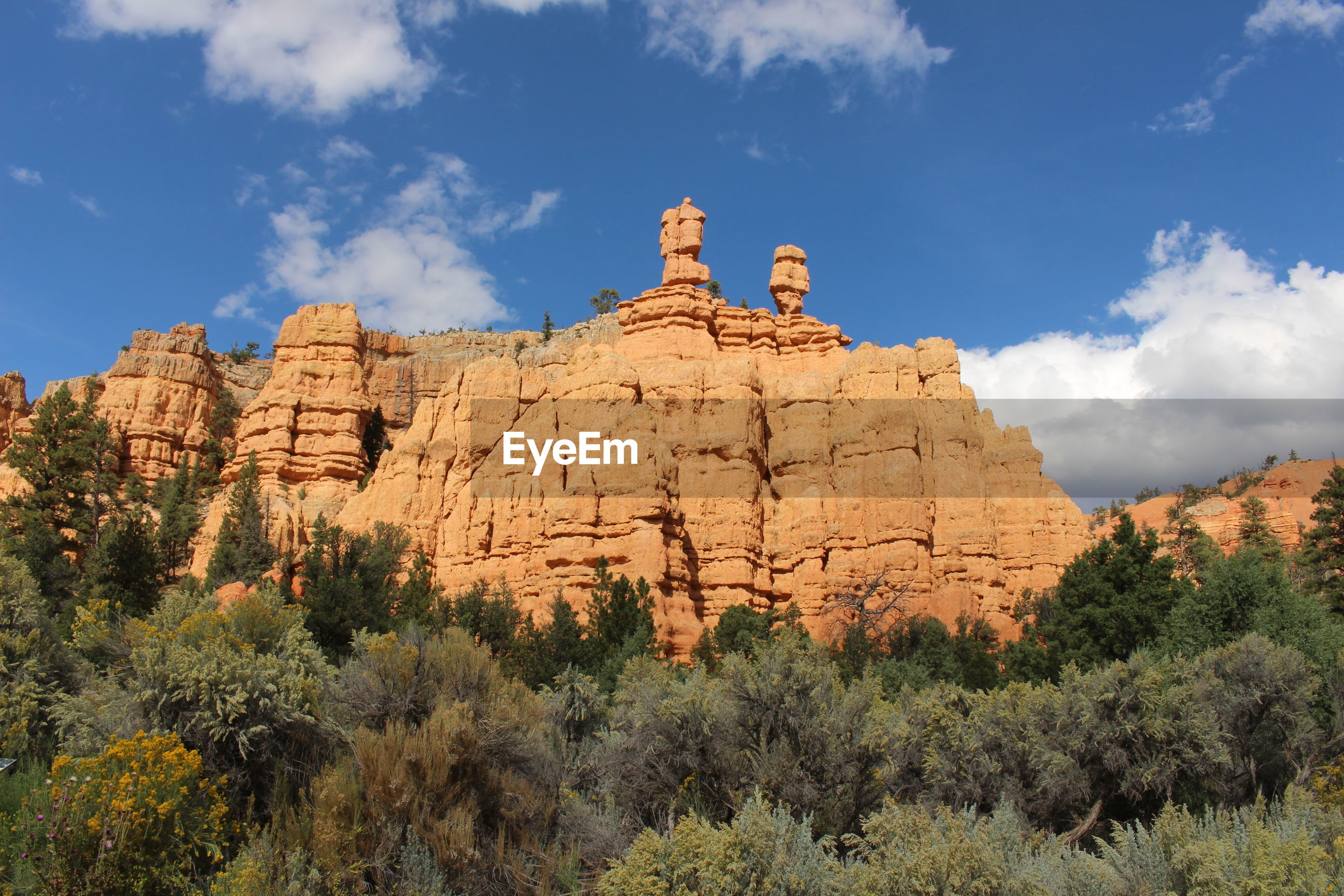 LOW ANGLE VIEW OF ROCK FORMATIONS ON LANDSCAPE