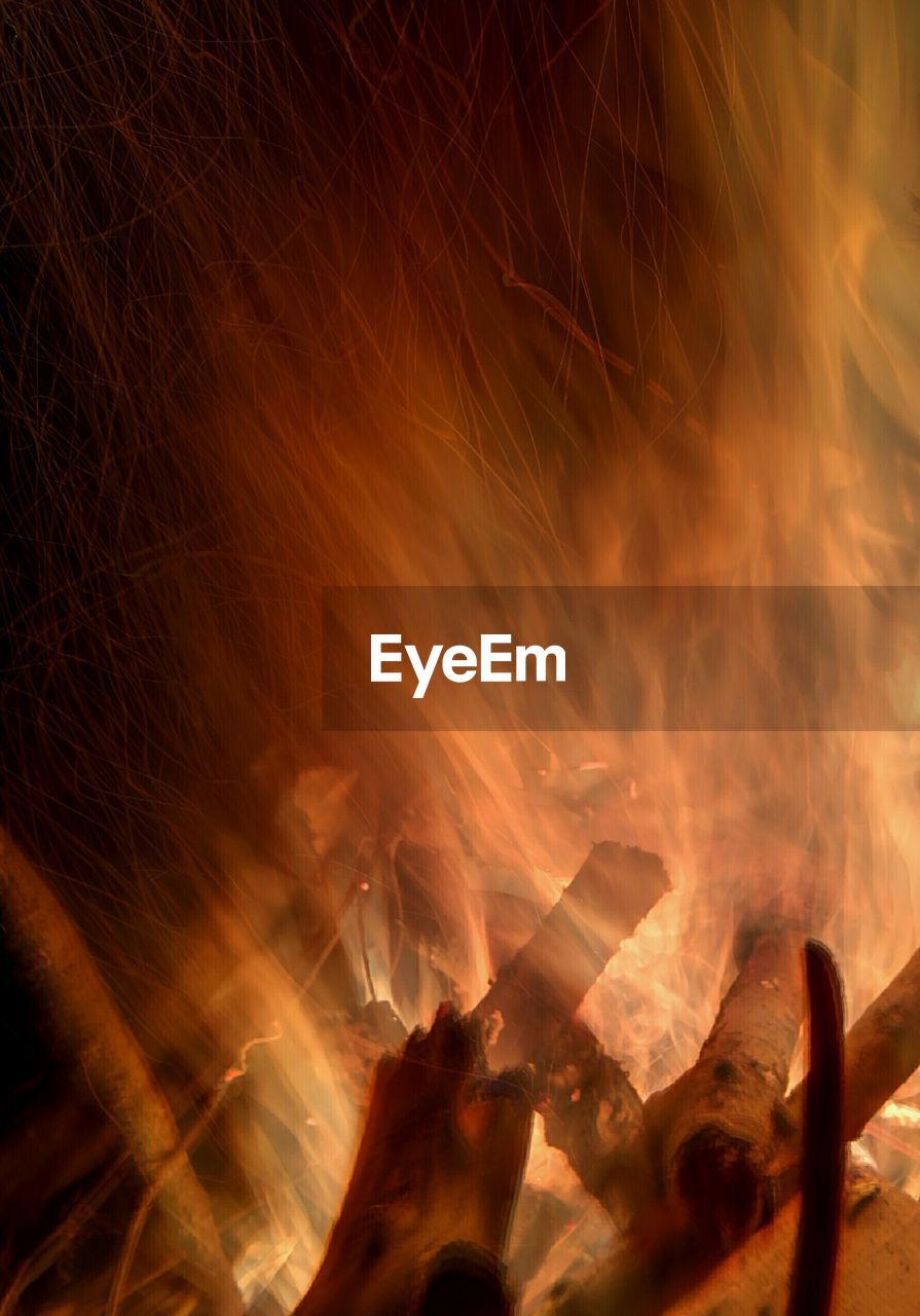 flame, burning, real people, heat - temperature, smoke - physical structure, fire, night, leisure activity, outdoors, bonfire, one person, close-up, human hand, people
