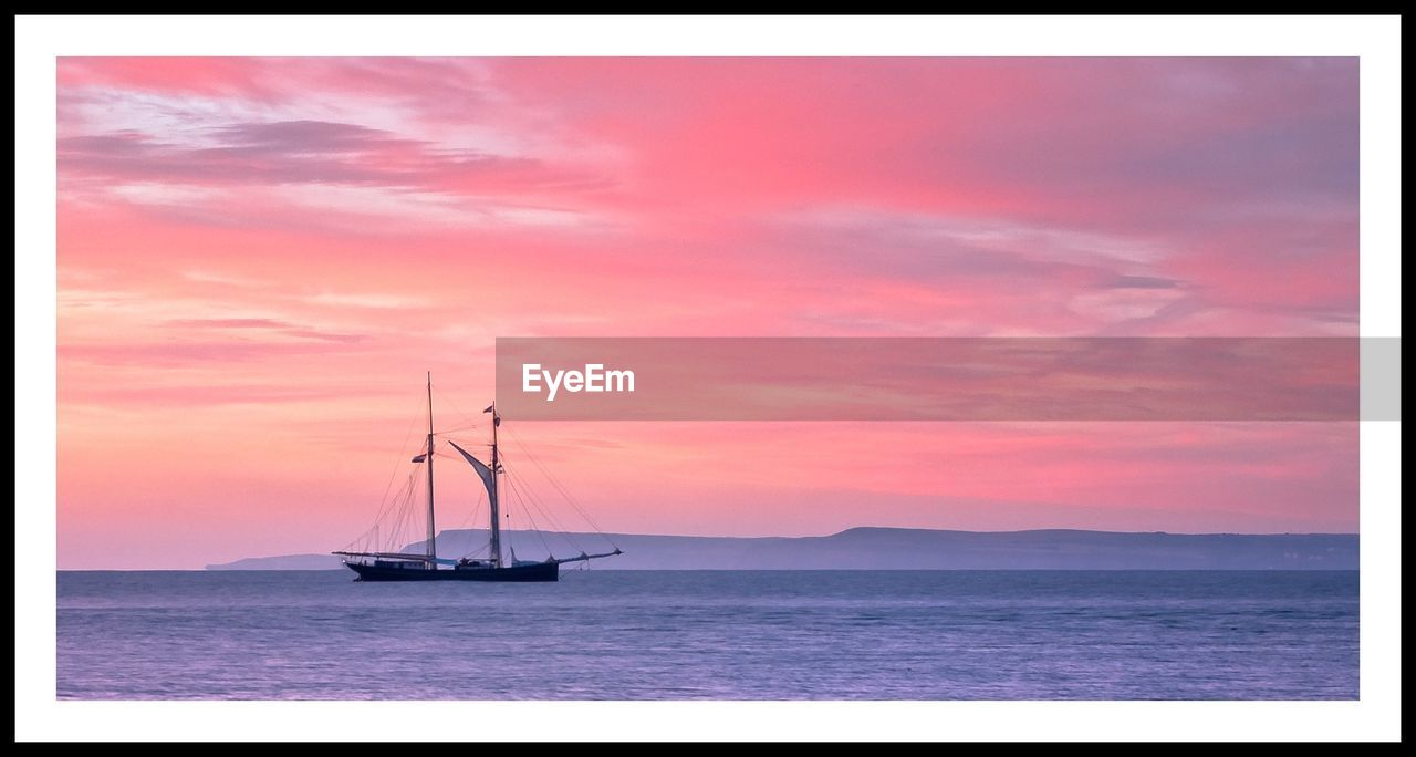 sunset, sea, sky, scenics, water, nature, tranquility, beauty in nature, nautical vessel, tranquil scene, no people, horizon over water, transportation, sailboat, silhouette, outdoors, cloud - sky, mode of transport, mast, day