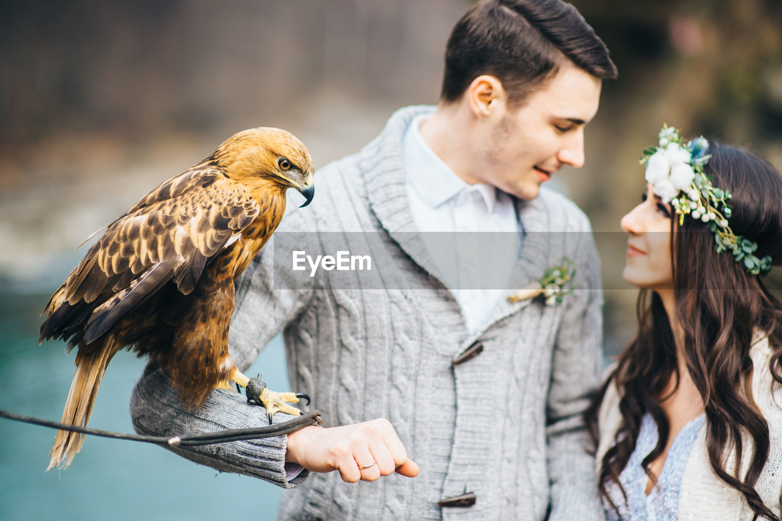 YOUNG COUPLE WITH BIRDS ON WALL