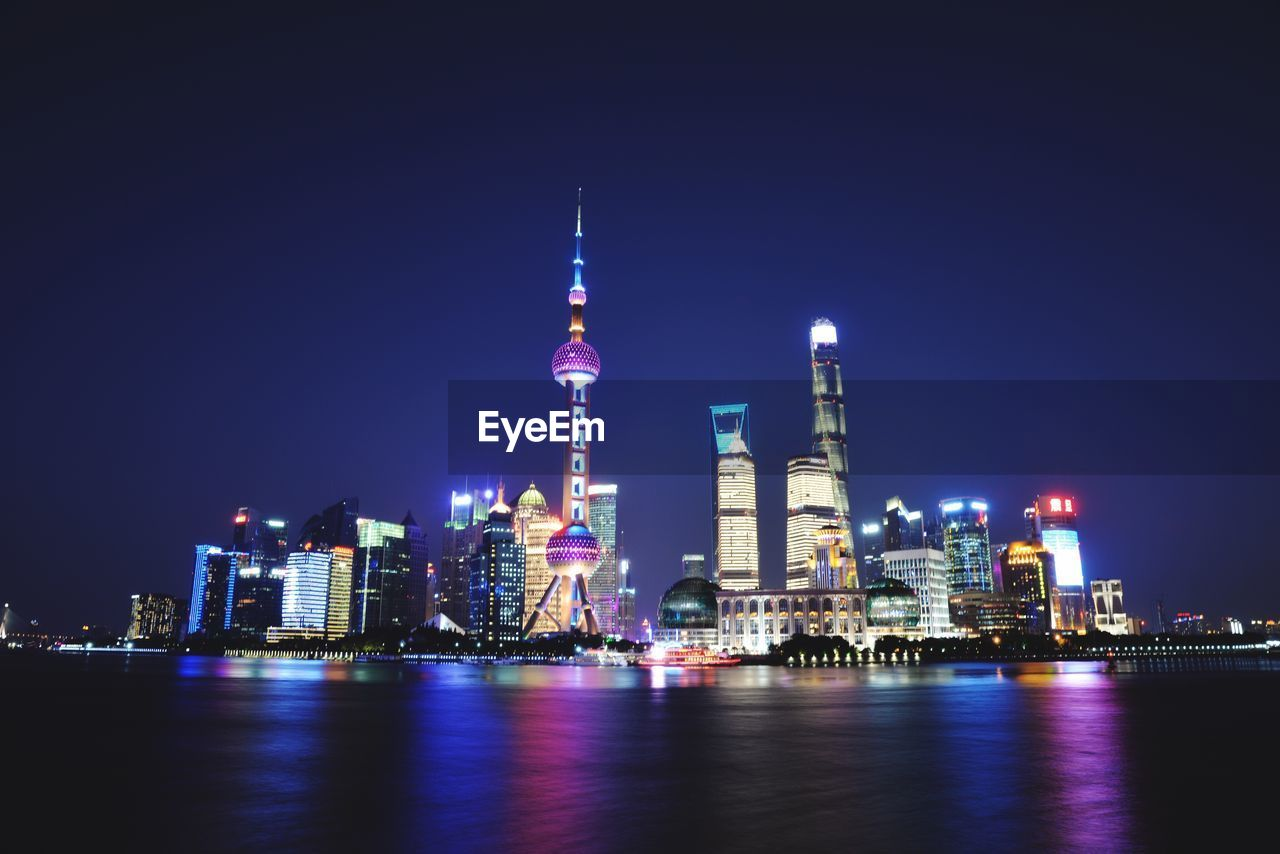 Bay Against Oriental Pearl Tower And Buildings And Night