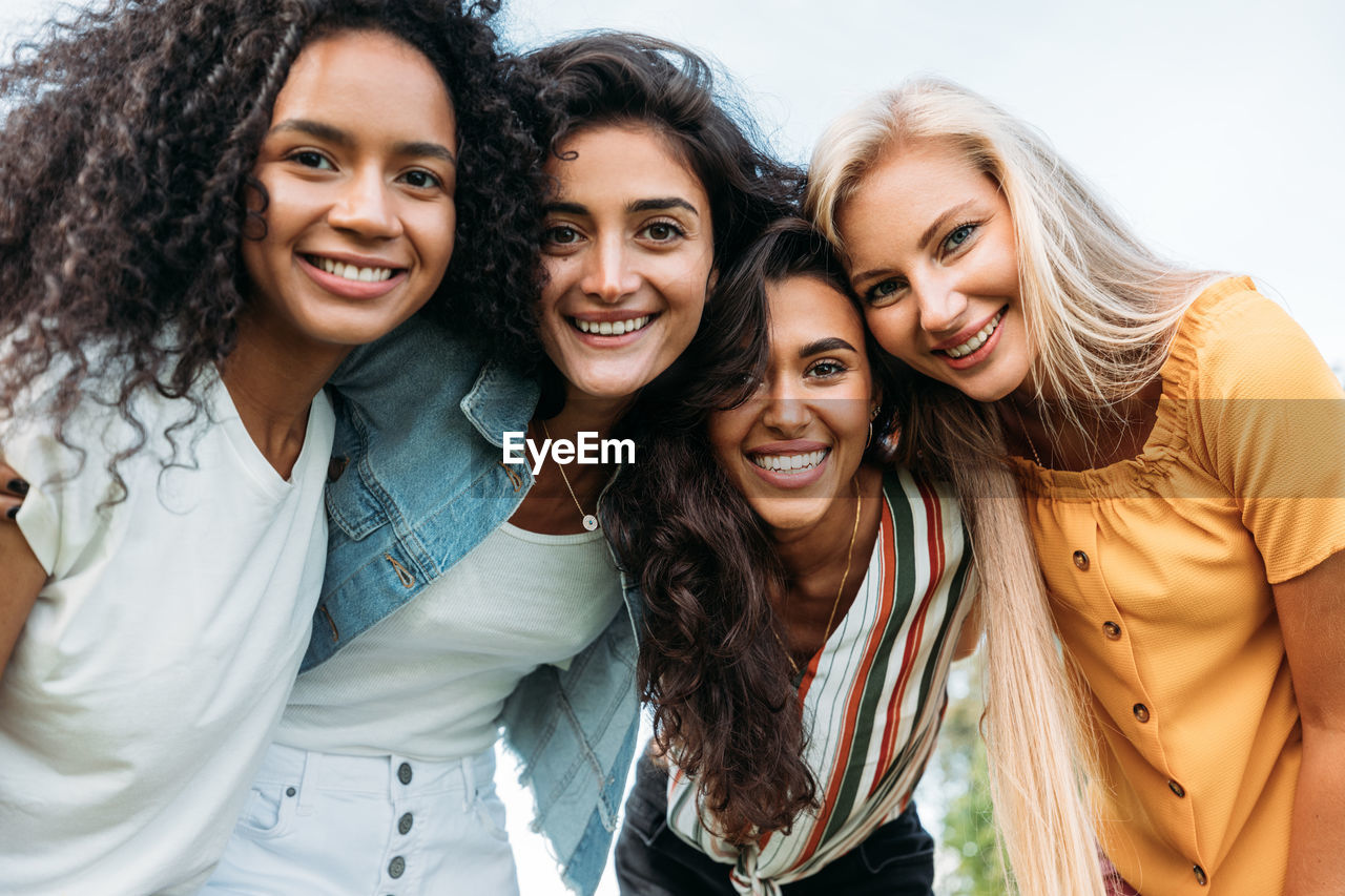 Portrait of female friends looking at camera